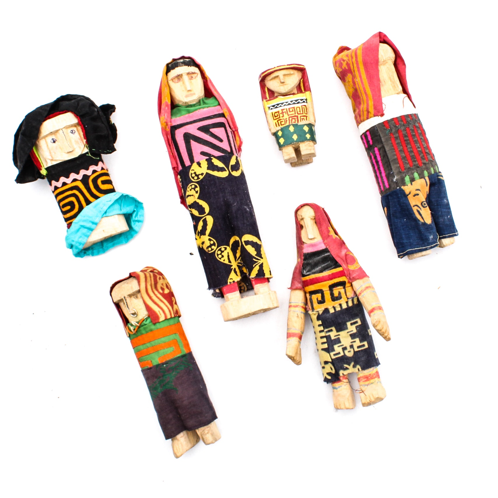 Panamanian Carved Figures with Mola Clothing