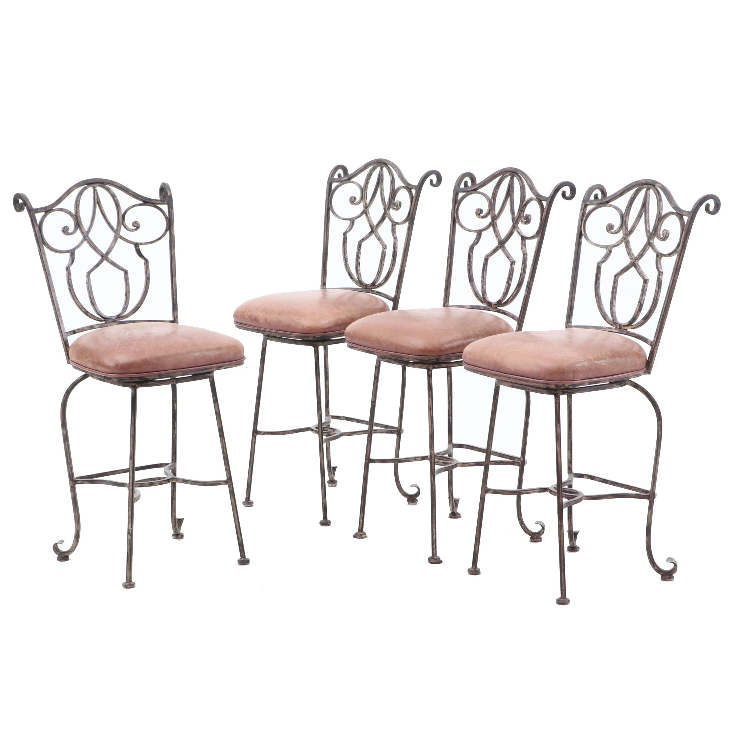 Four Wrought Iron Swivel Bar Stools
