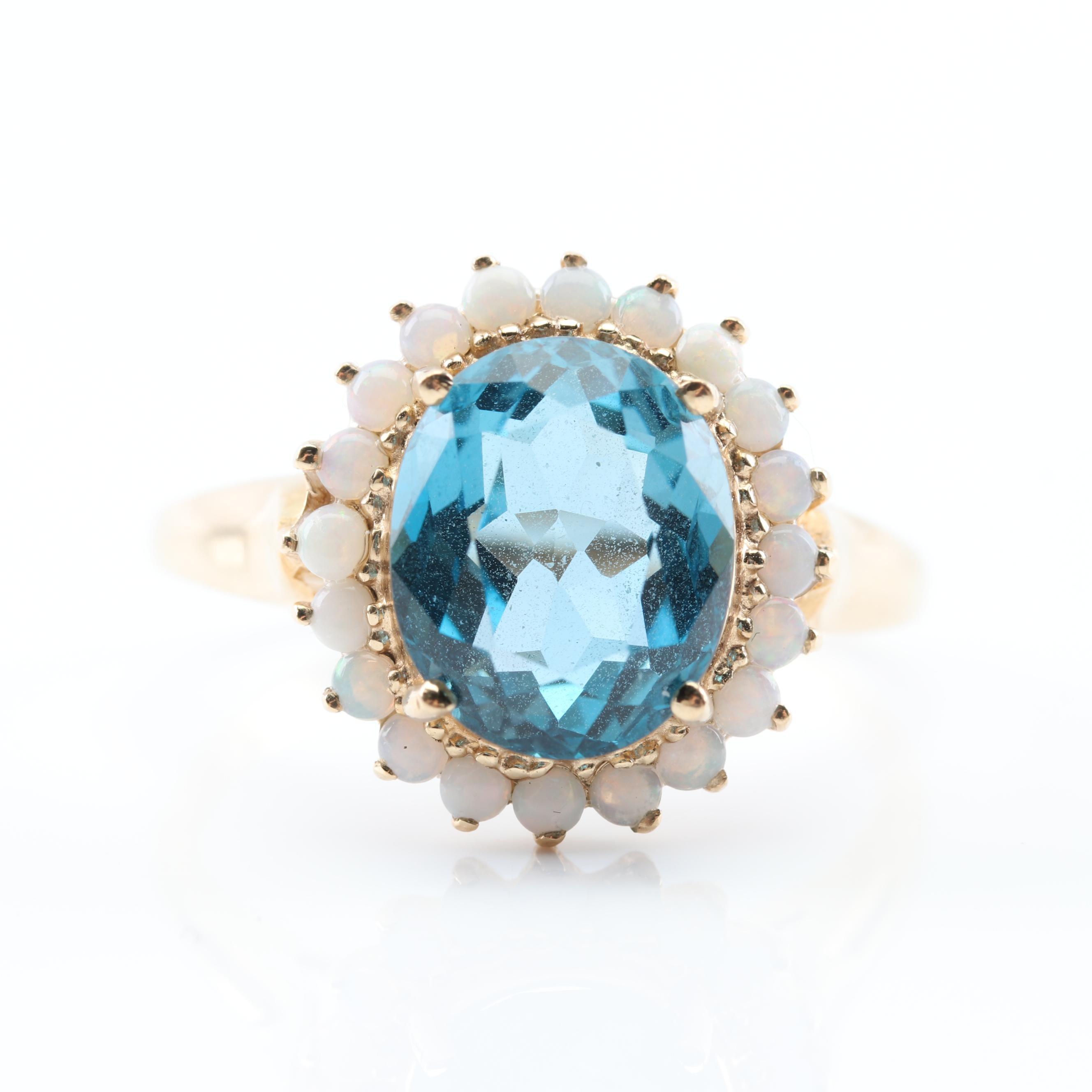 10K Yellow Gold Blue Topaz and Opal Halo Ring