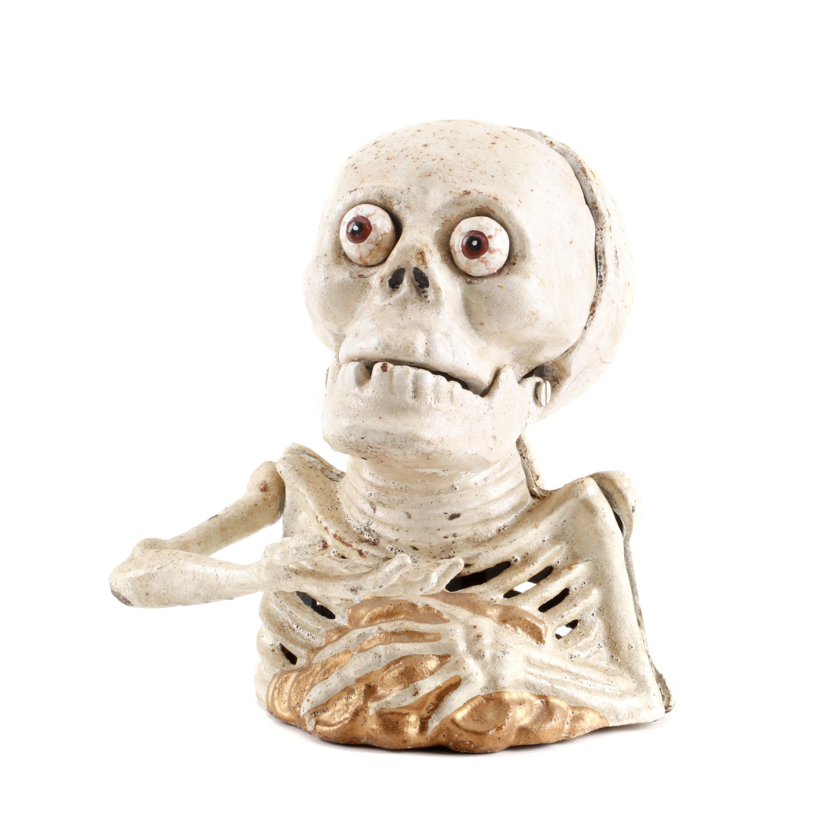 Reproduction Cast Iron Figural Skeleton with a Brain Coin Bank