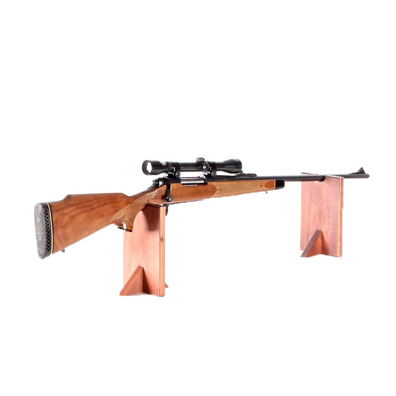 Remington Model 700 7mm Rifle with Rail Mounted Weaver Scope and Leather Sling