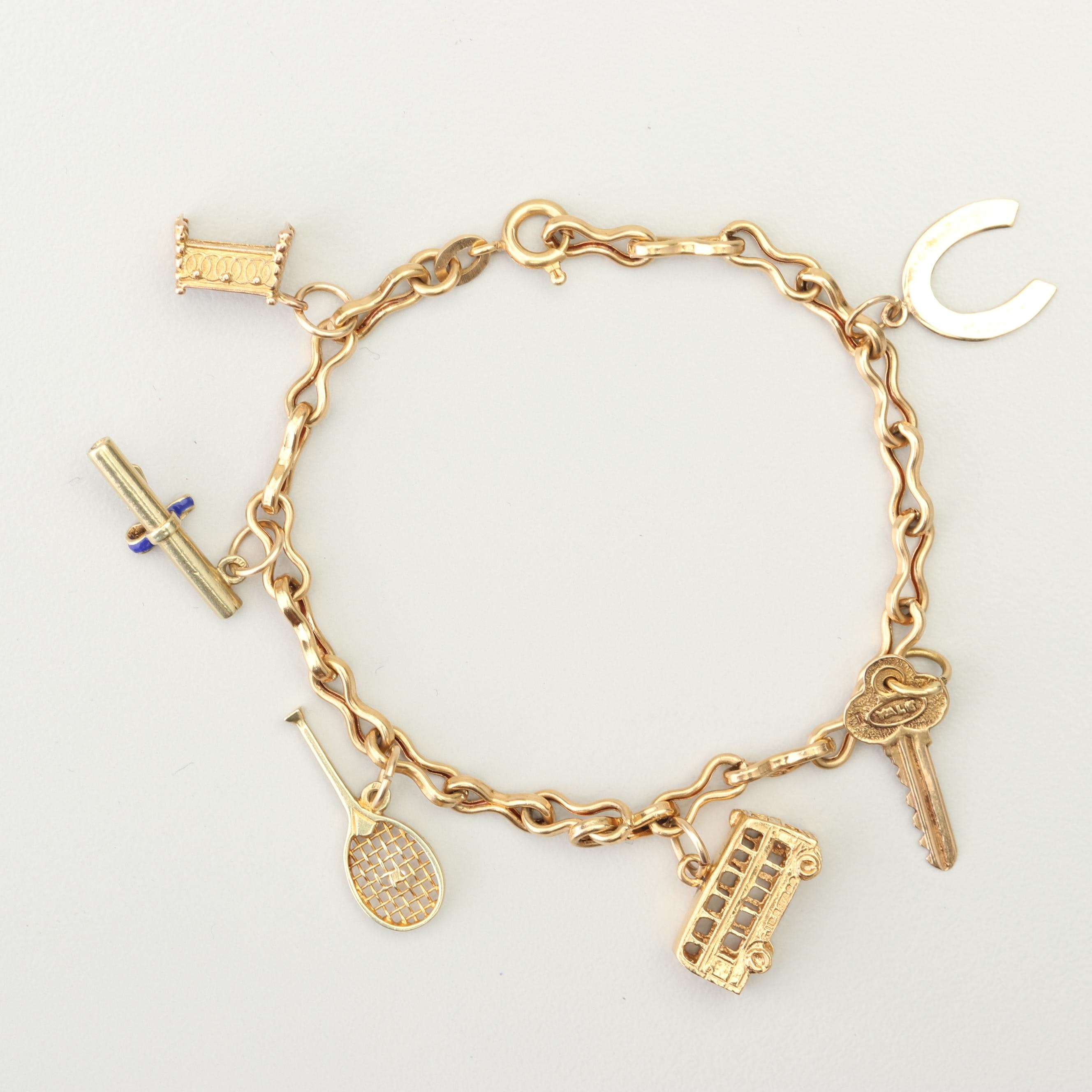 18K Yellow Gold Charm Bracelet with 14K and 10K Yellow Gold Charms