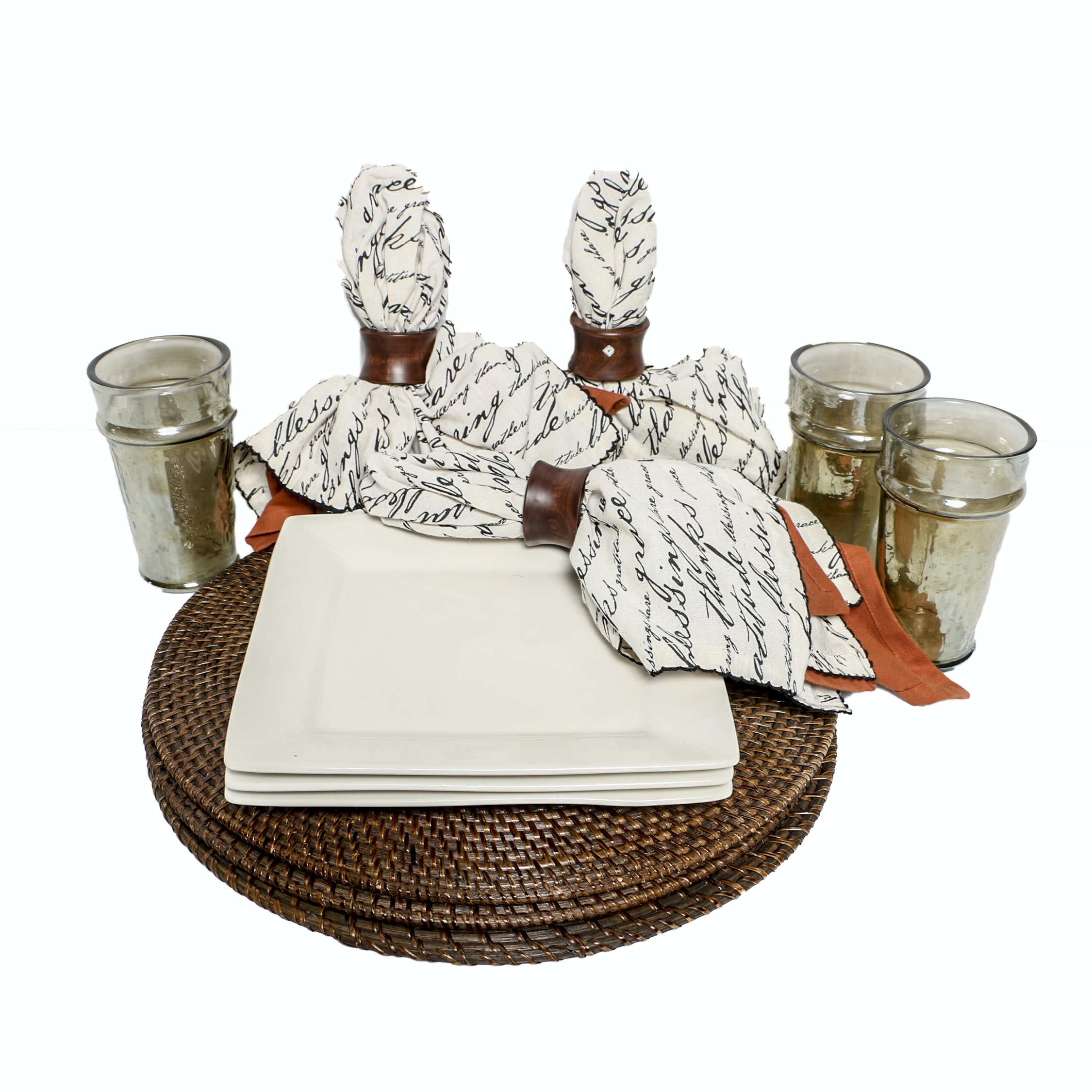Contemporary Place Settings with Wicker Placemats and Printed Napkins