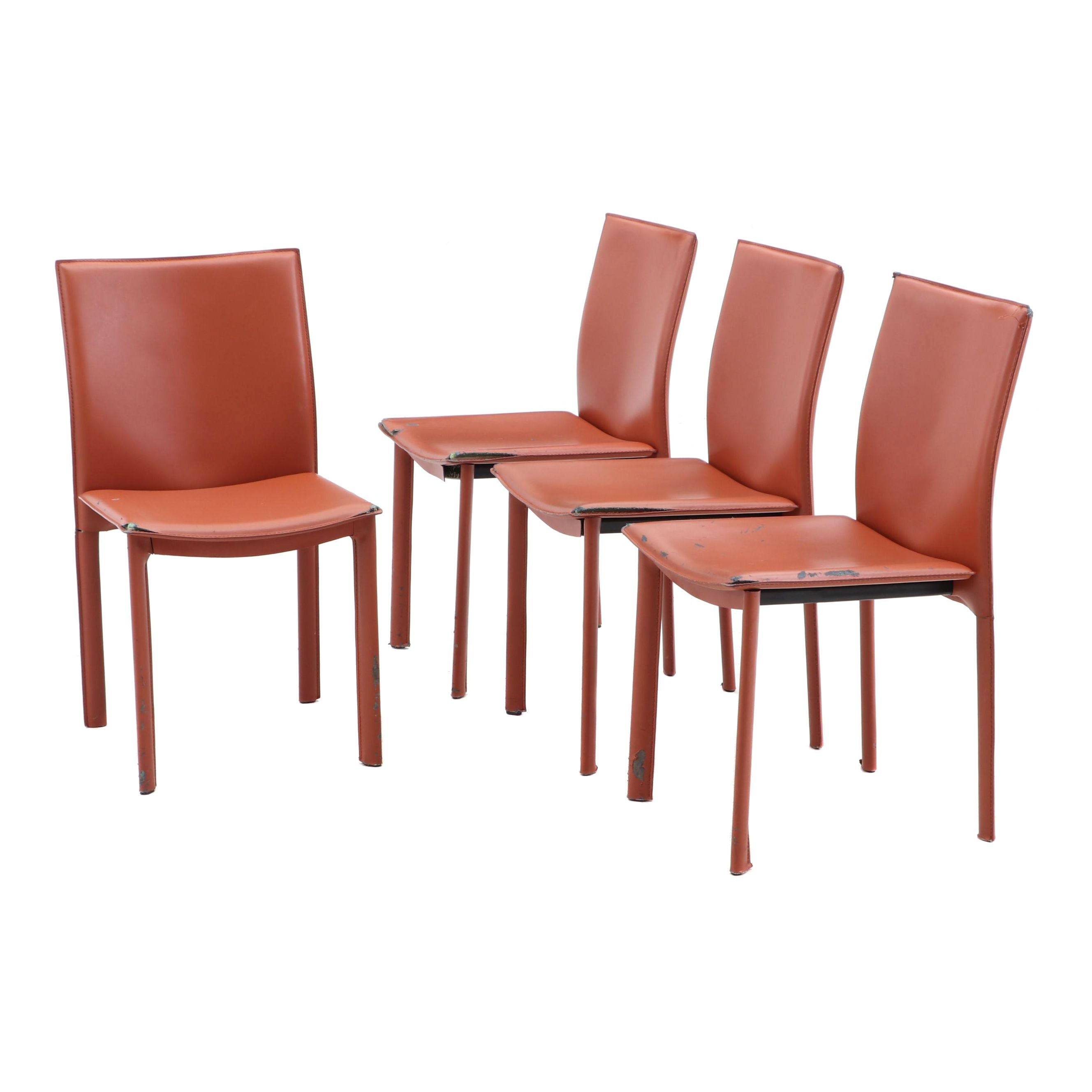 Four Faux Leather Upholstered Side Chairs