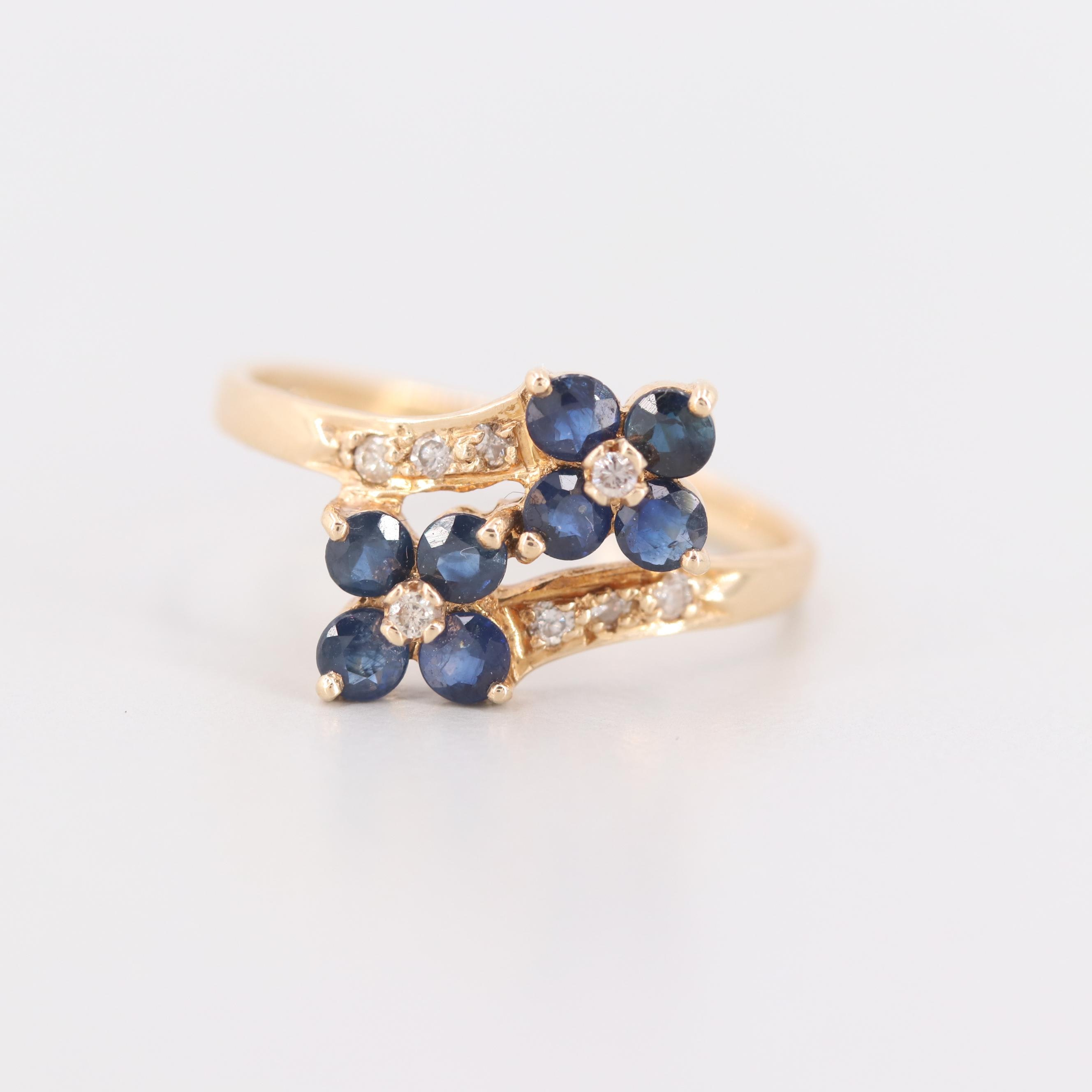 14K Yellow Gold Blue Sapphire and Diamond Bypass Flower Motif Ring