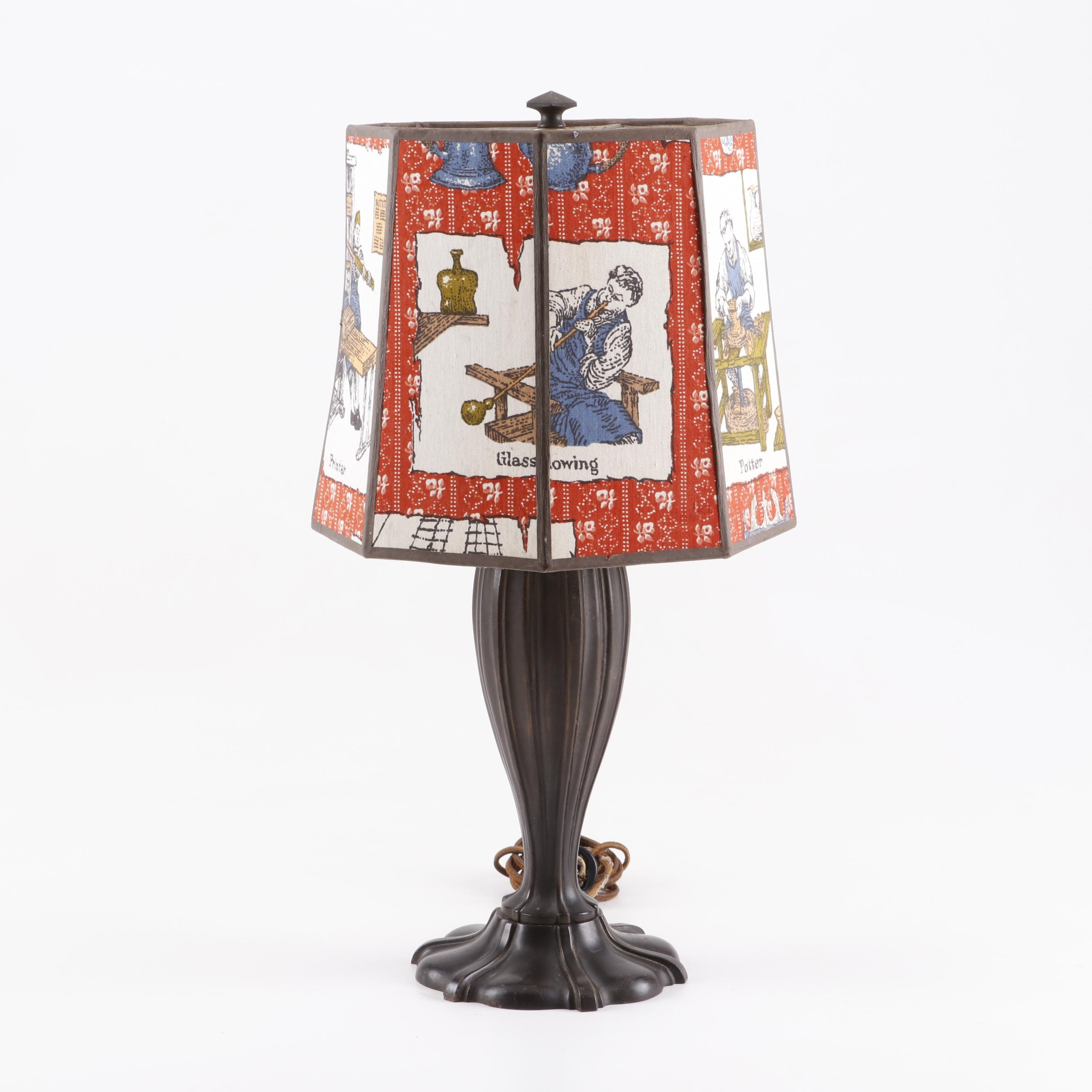 Cast Metal Table Lamp with Printed Shade Depicting 18th Century Trades
