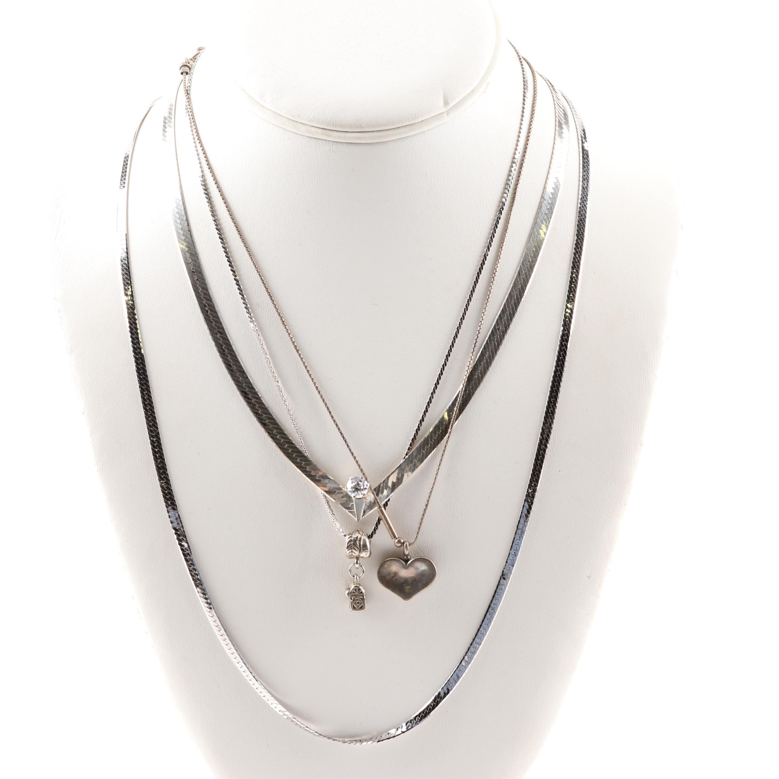 Sterling Silver Cubic Zirconia Herringbone, Heart, and Purse Pendant Necklaces