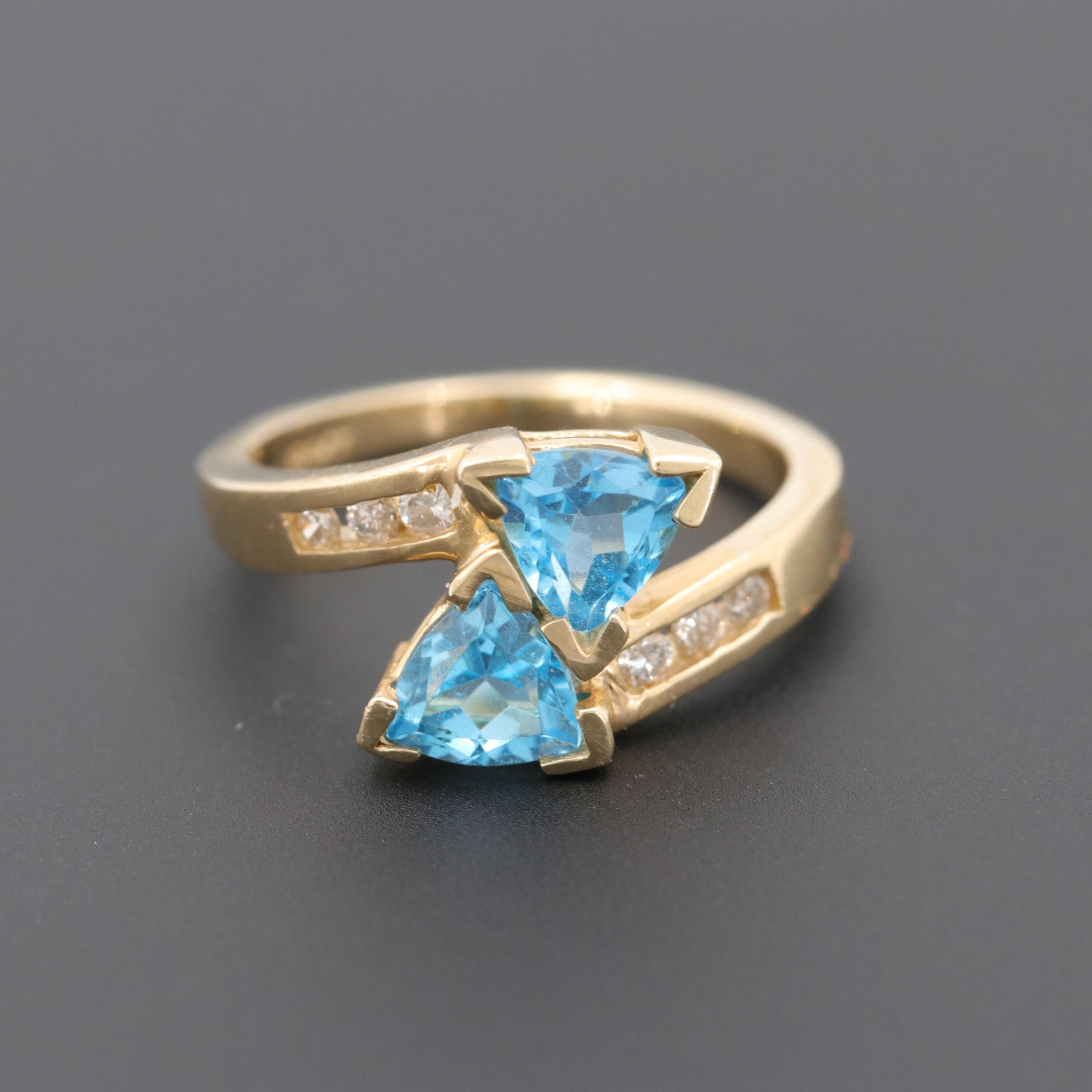 14K Yellow Gold Blue Topaz and Diamond Bypass Ring
