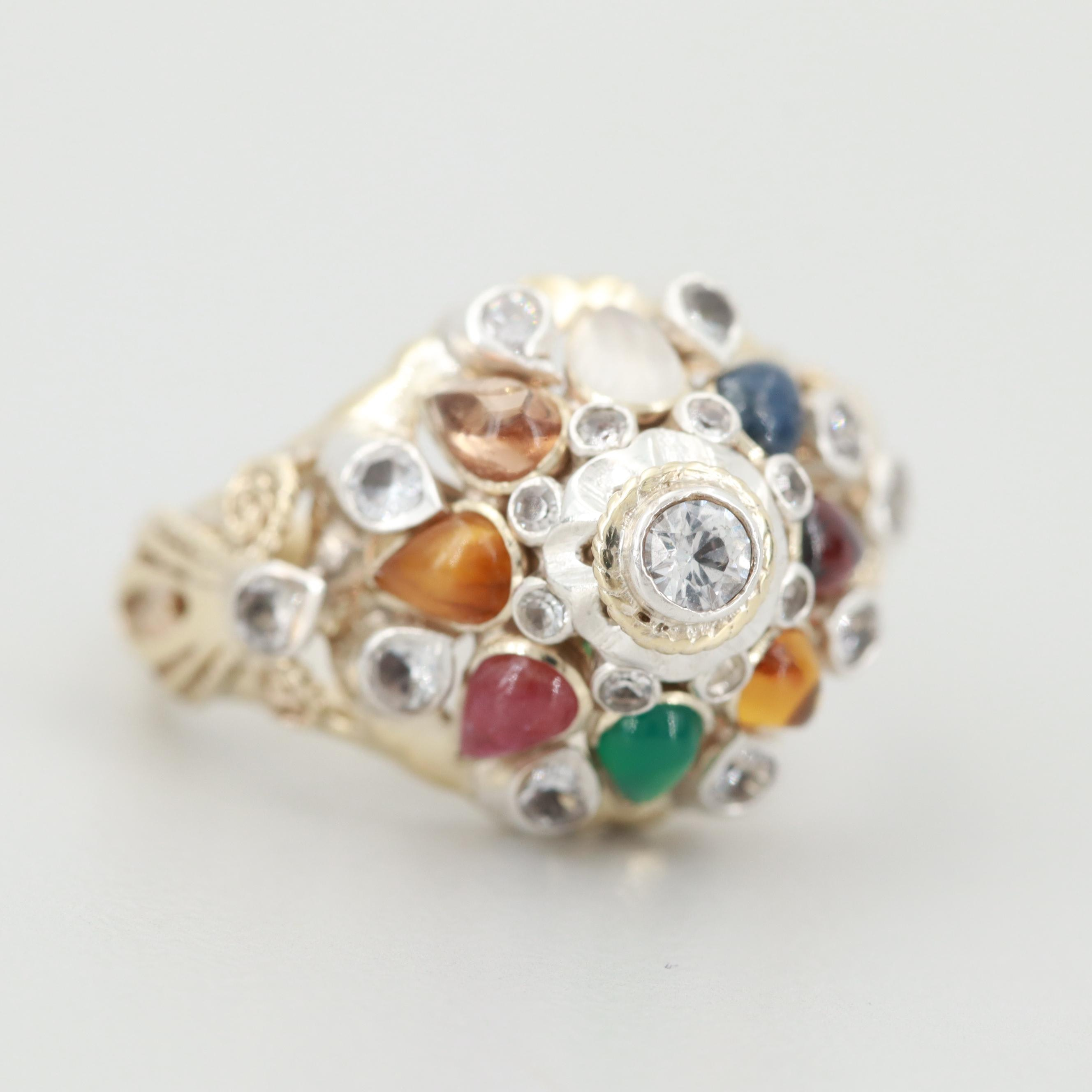 800 Silver and 9K Yellow Gold Synthetic White Spinel and Garnet Ring