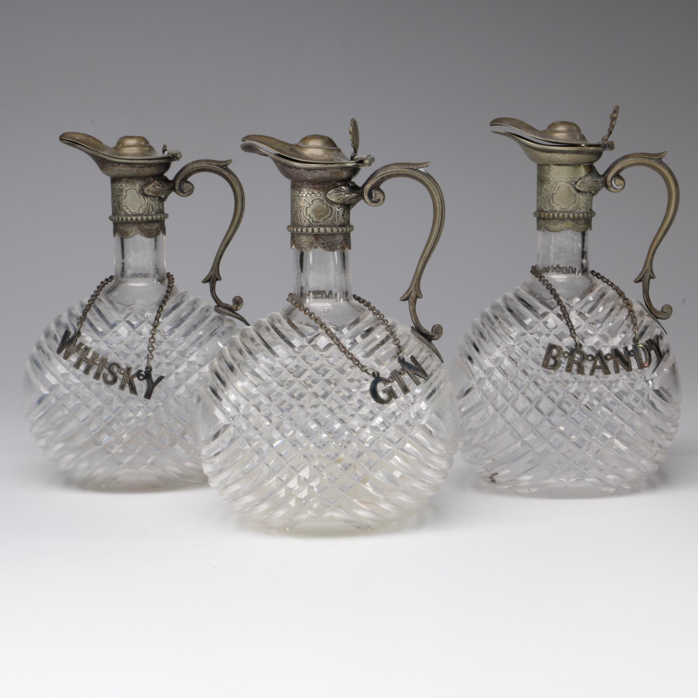 Crystal Claret Decanters with Silver Plate Spouts and Liquor Tags