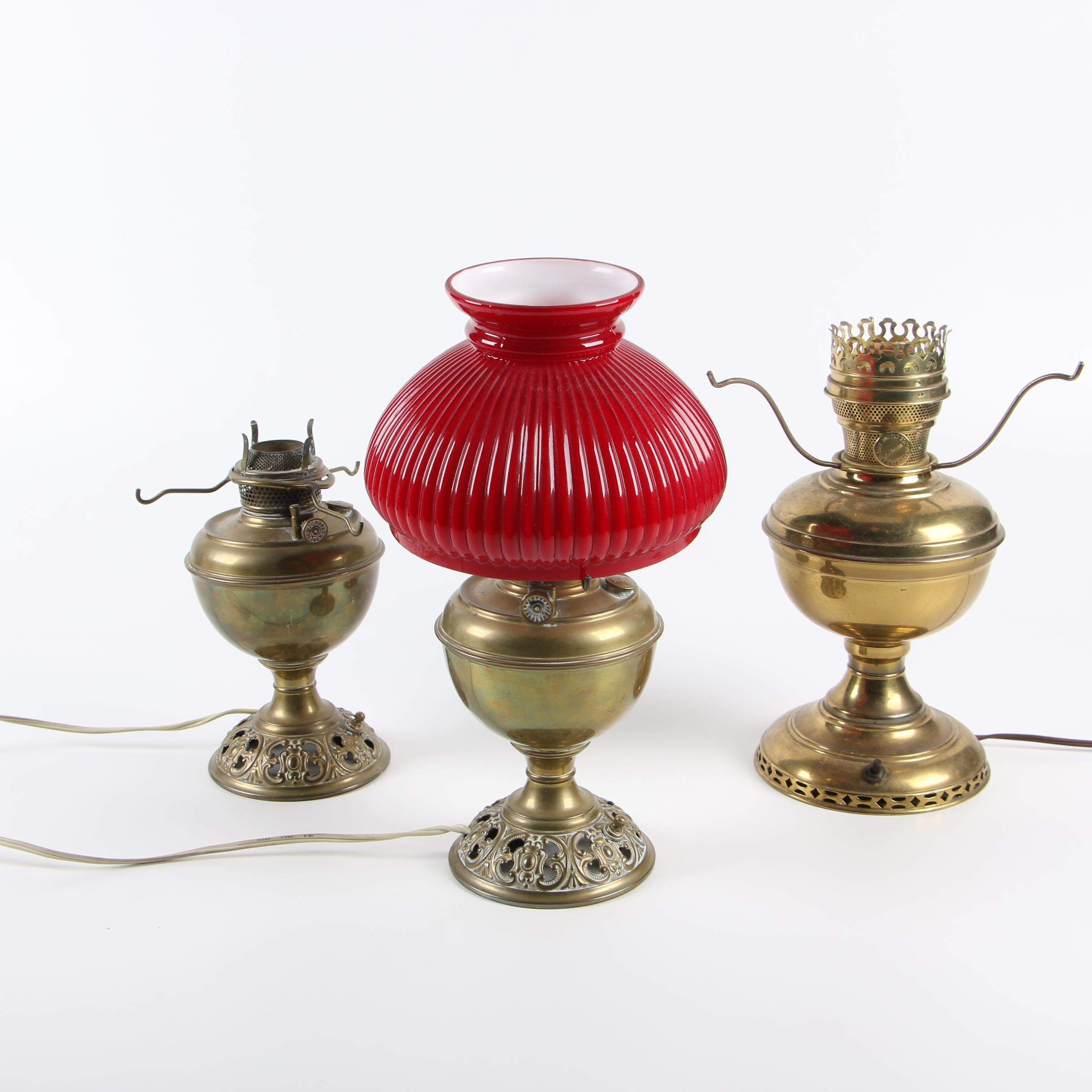 Bradley and Hubbard Converted Oil Lamps with Red Cased Glass Shade