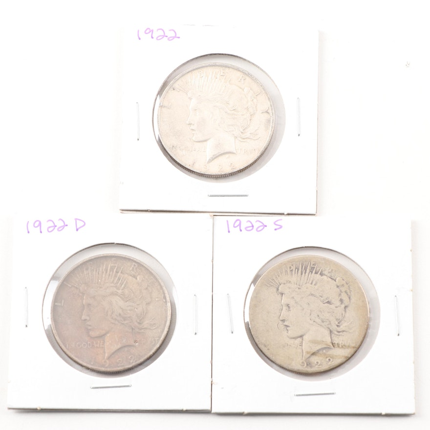 1922, 1922 S, and a 1922 D Peace Silver Dollar
