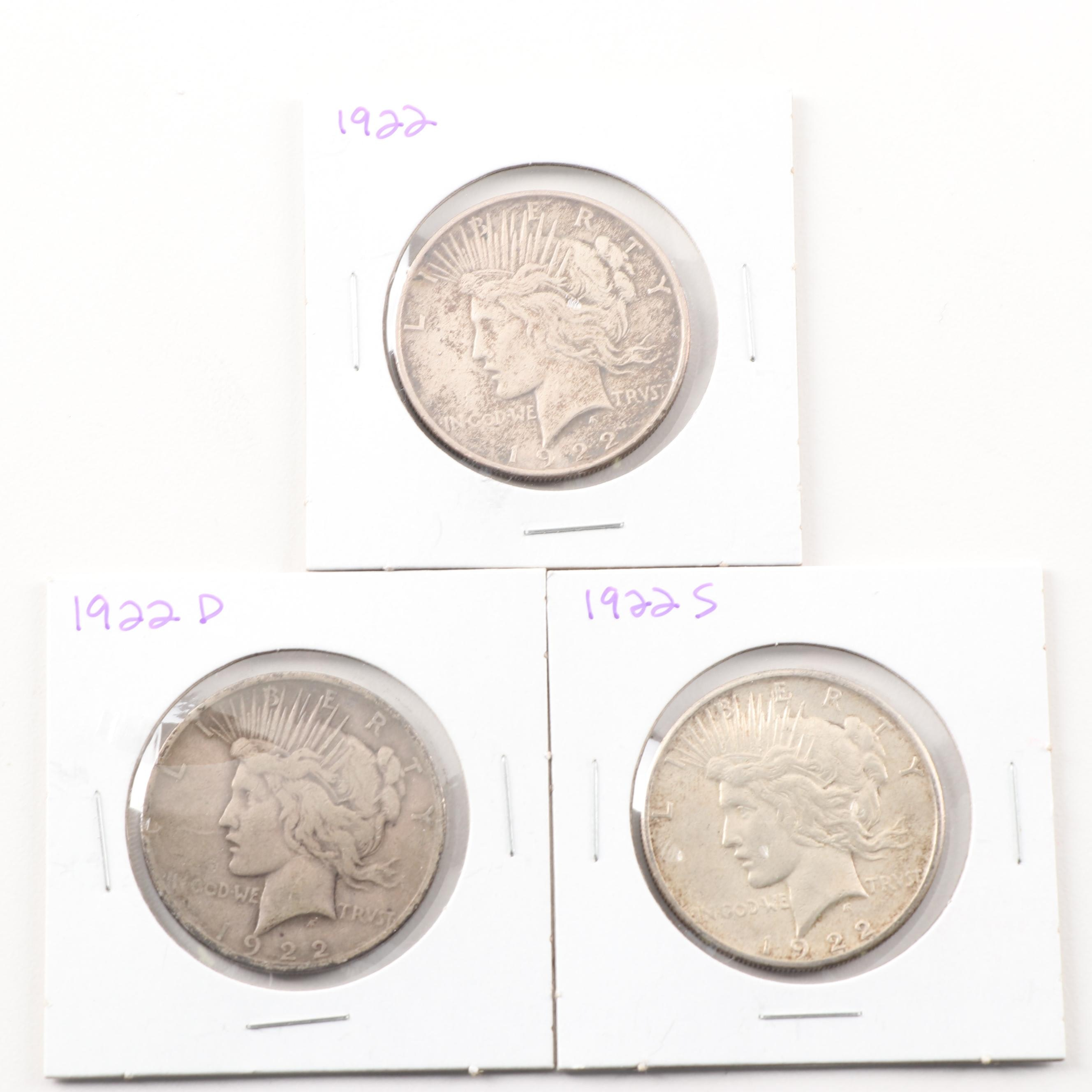 1922, 1922 D and a 1922 S Peace Silver Dollars