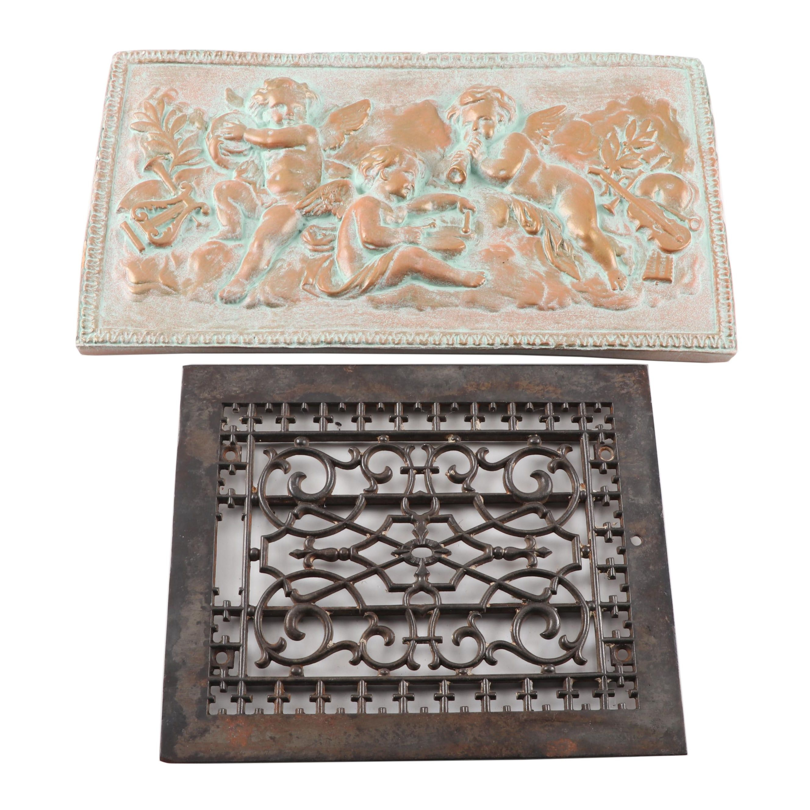 Architectural Cast Iron Grate and Verdigris and Gilt Putti Wall Plaque