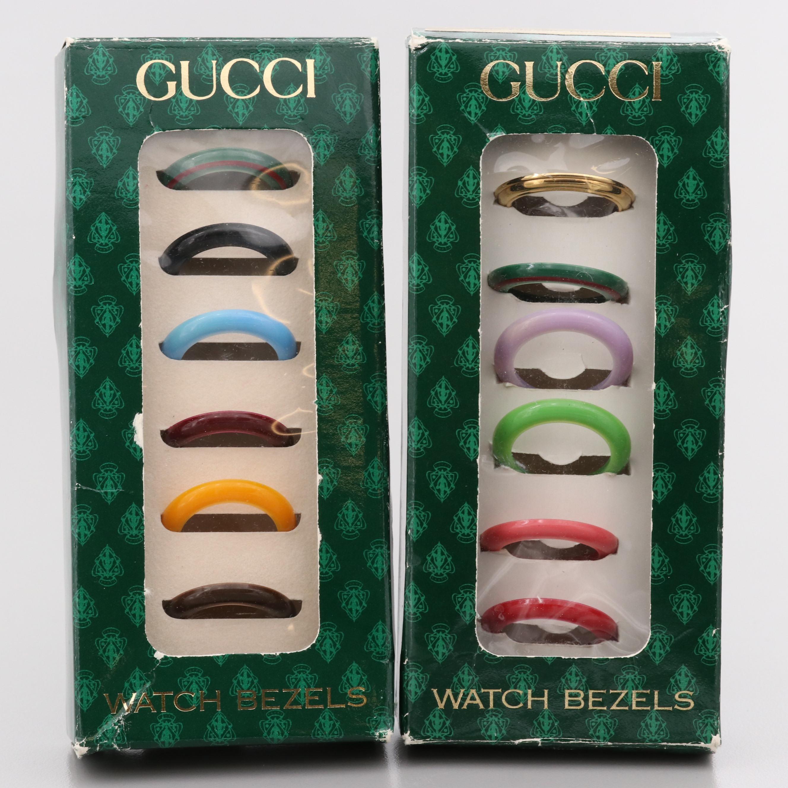 Twelve Gucci Plastic and Metal Watch Bezels