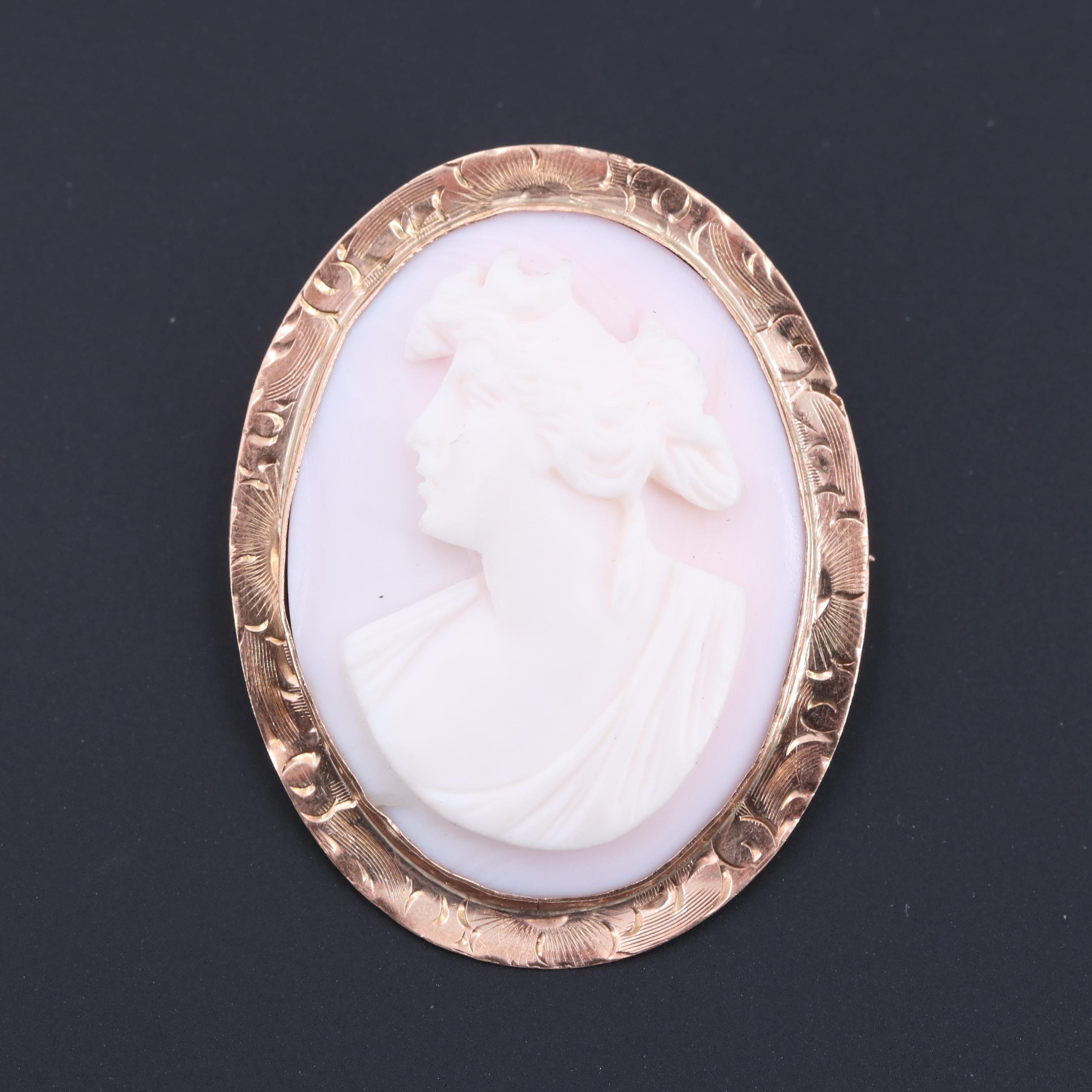 Circa 1910s 10K Rose Gold Carved Conch Shell Artemis Cameo Converter Brooch