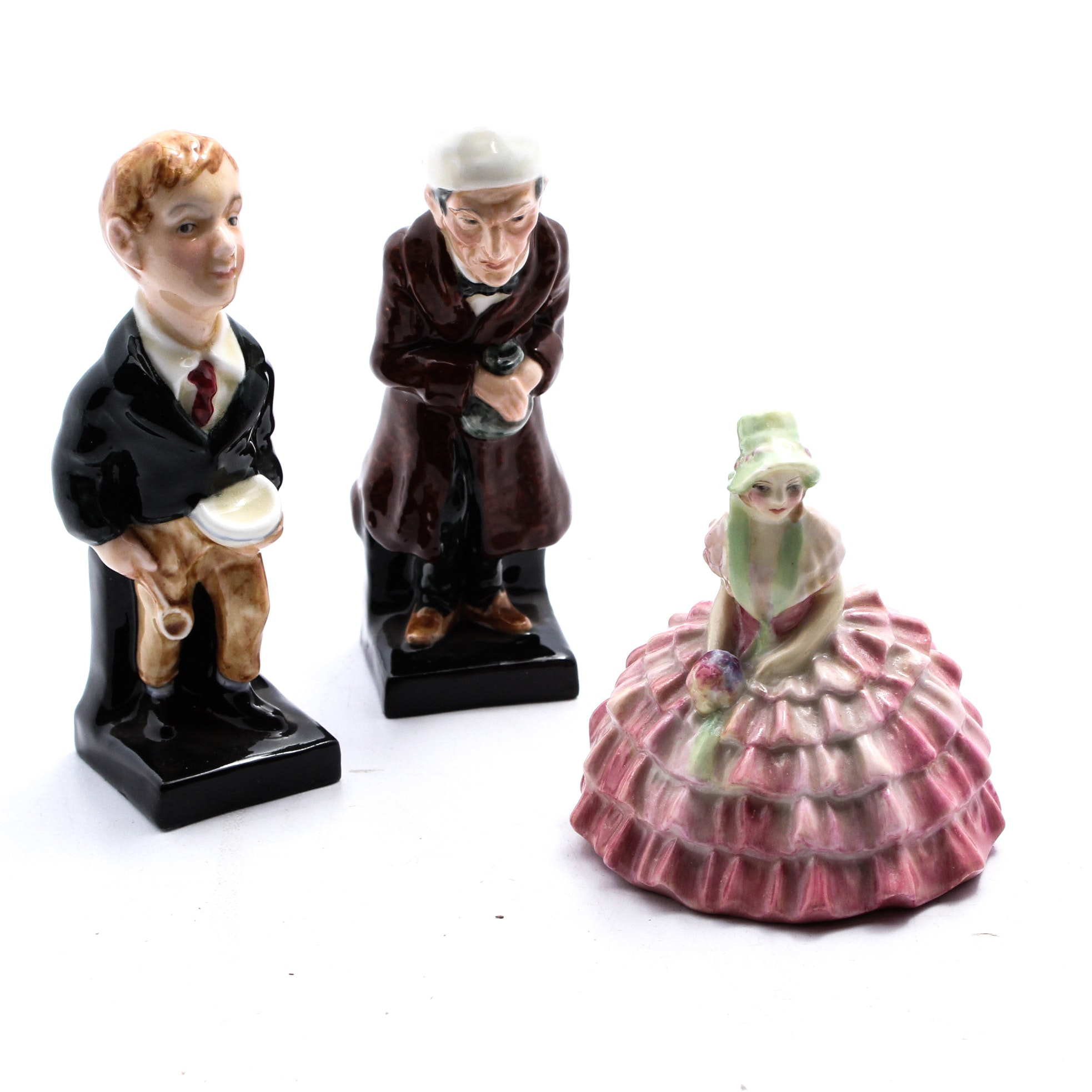 "Royal Doulton Ceramic Figurines ""Oliver Twist"" and ""Scrooge"""