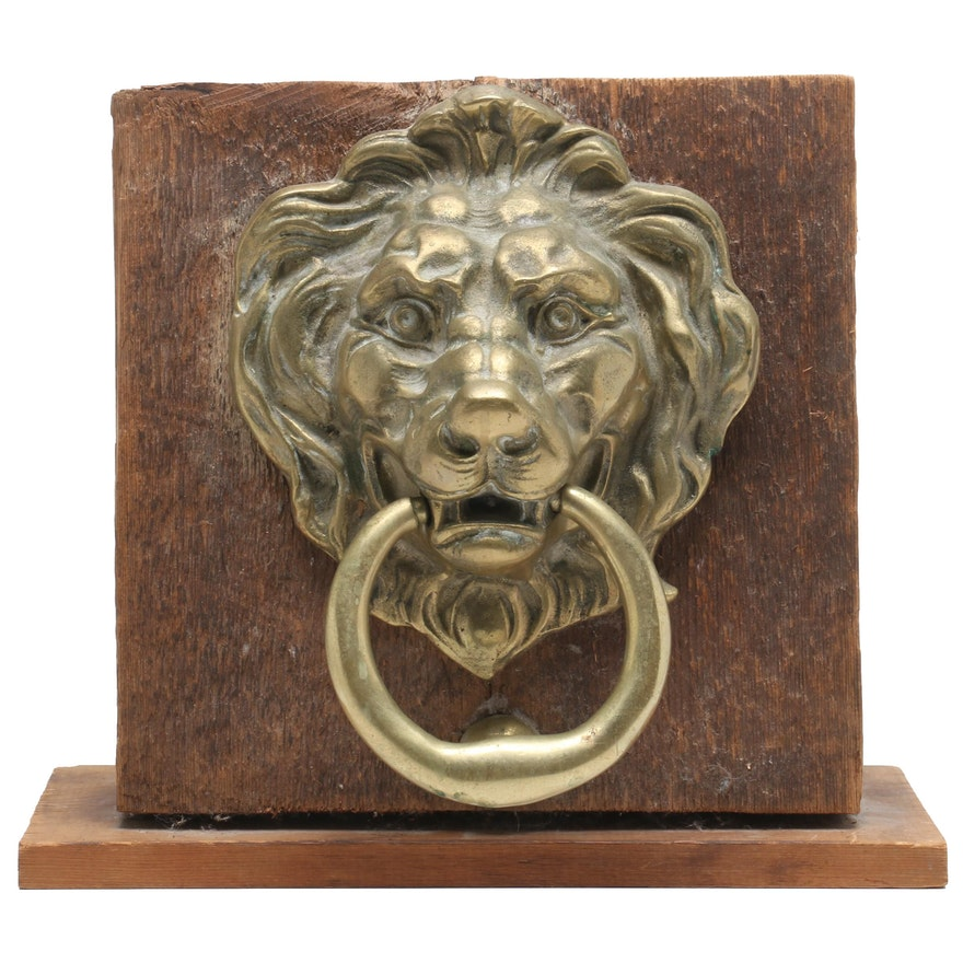 Brass Lionhead Door Knocker Mounted On Wooden Base