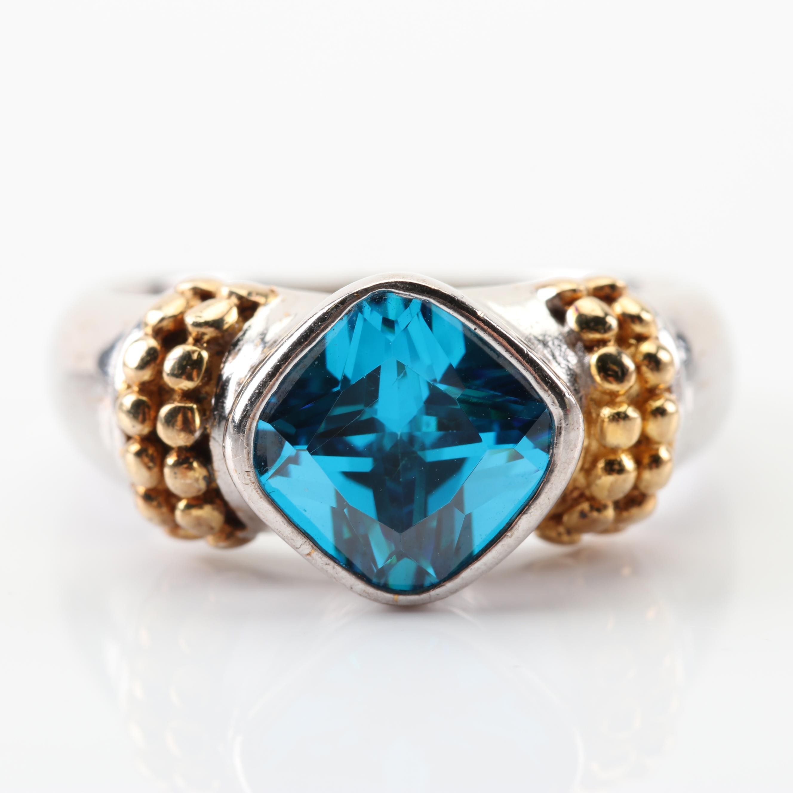 Sterling Silver Simulated Blue Stone Ring With Gold Wash Beaded Accents