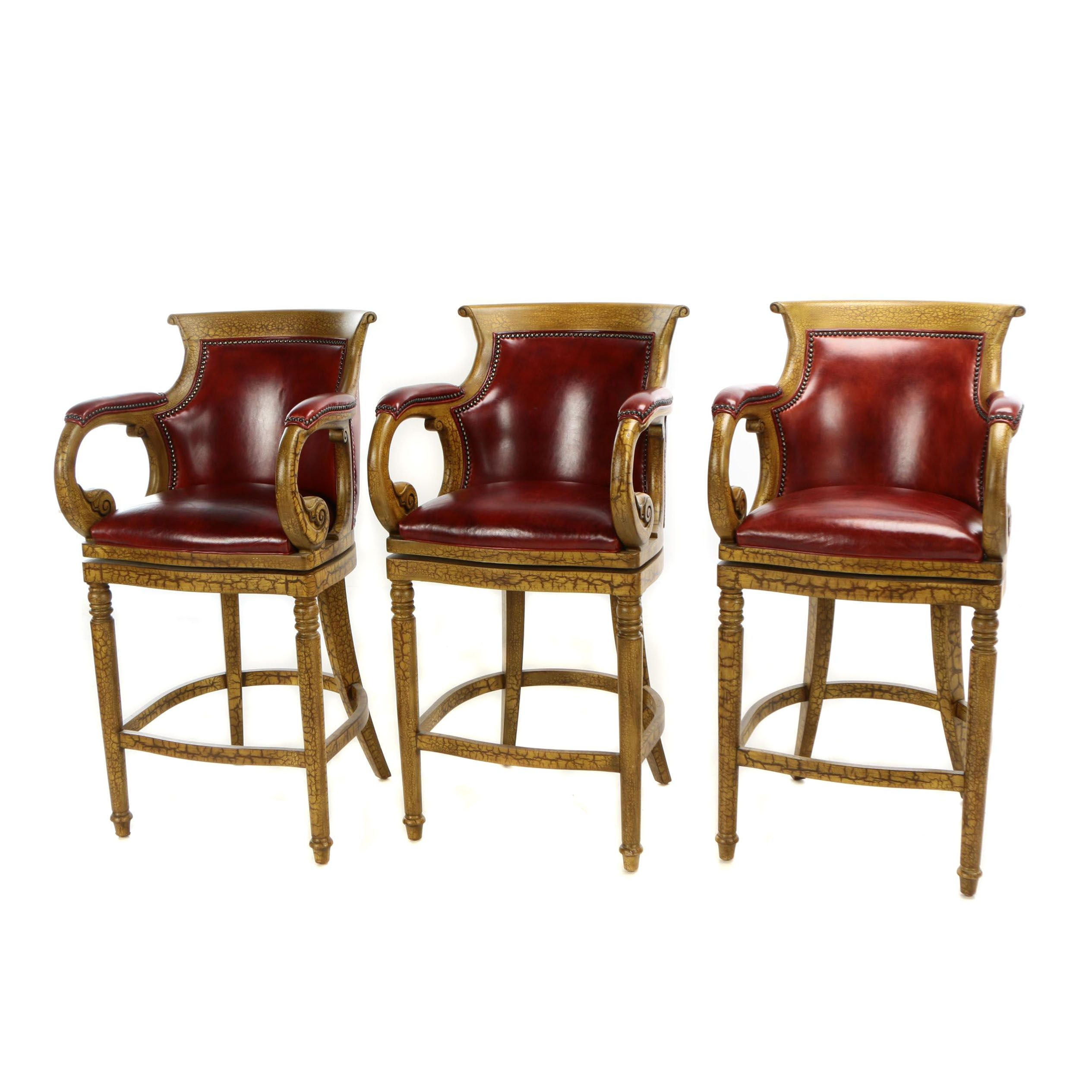 Three Hancock & Moore Yellow-Painted and Dark Red Leather Swivel Barstools
