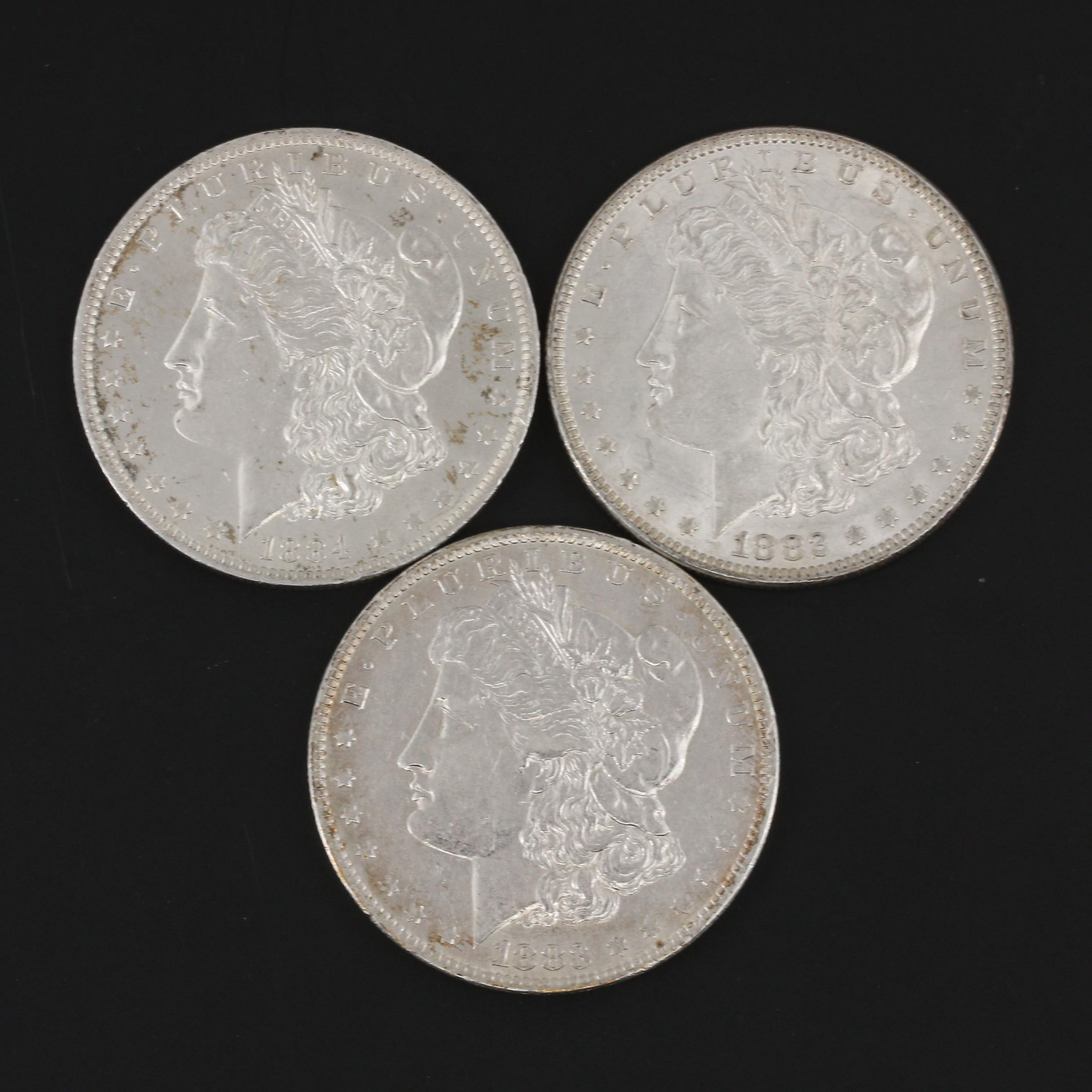 Group of Three Silver Morgan Dollars: 1882, 1883-O, and 1884-O