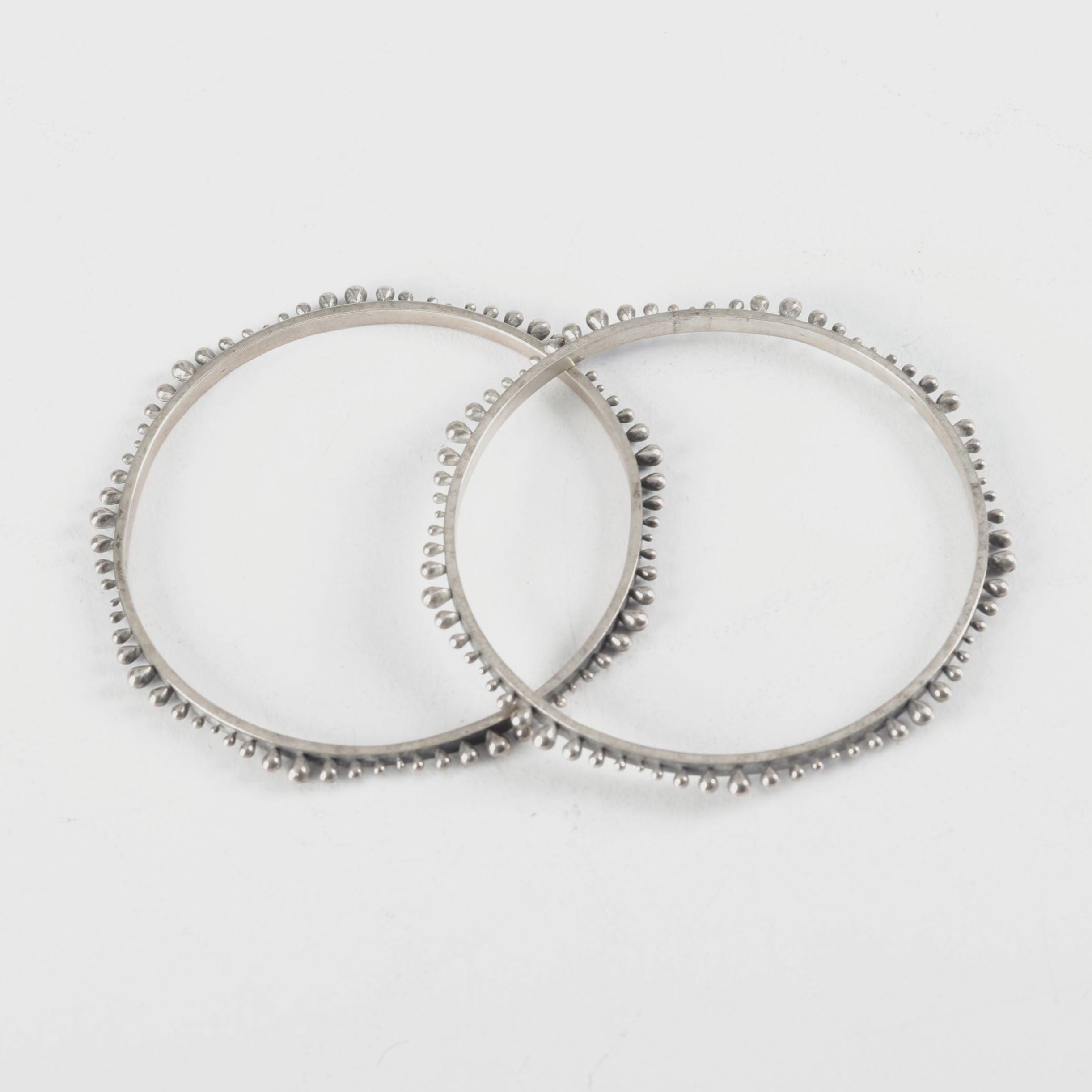 Pair of Hand Cast Sterling Silver Bangles