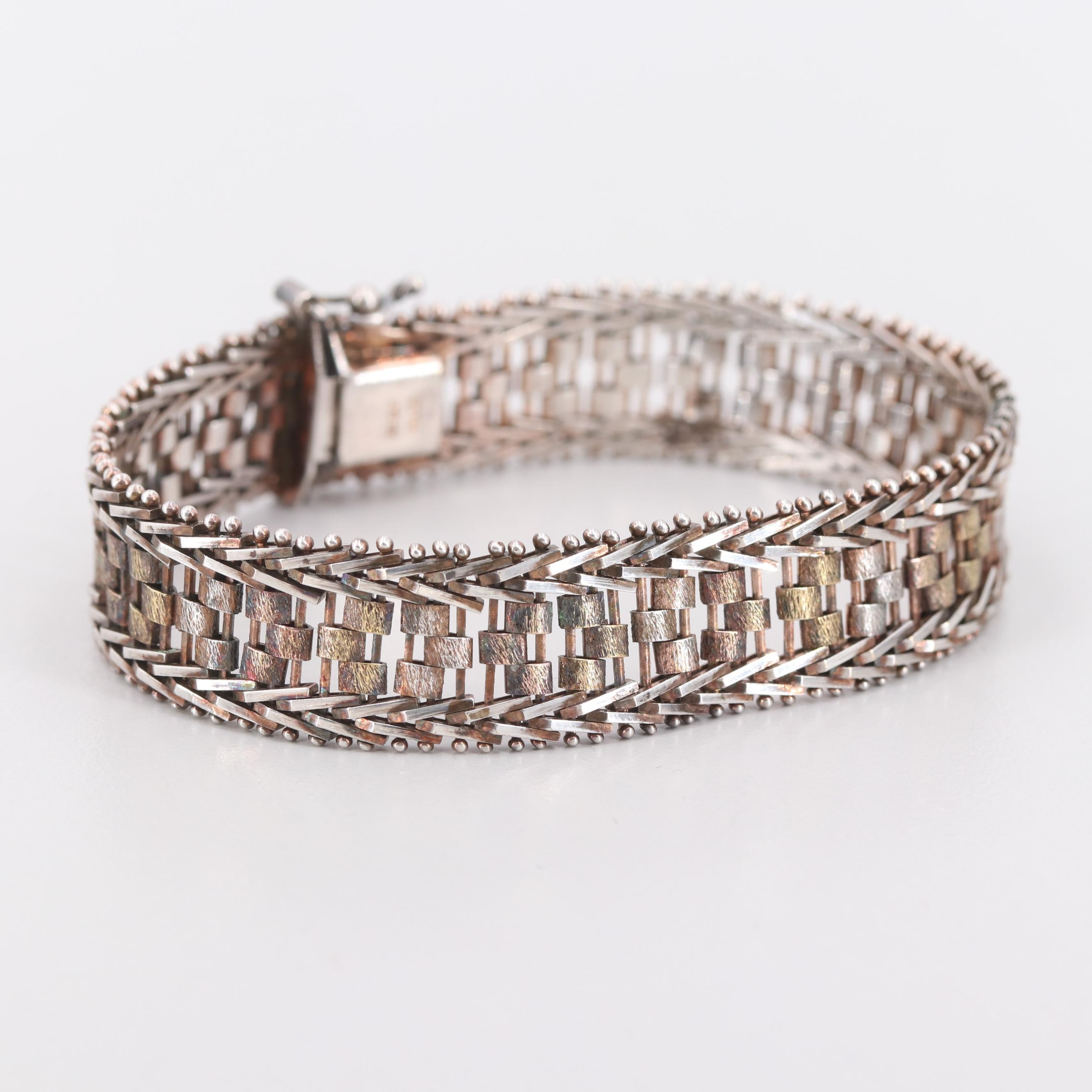 Sterling Silver Bracelet with Rose Tone Accents