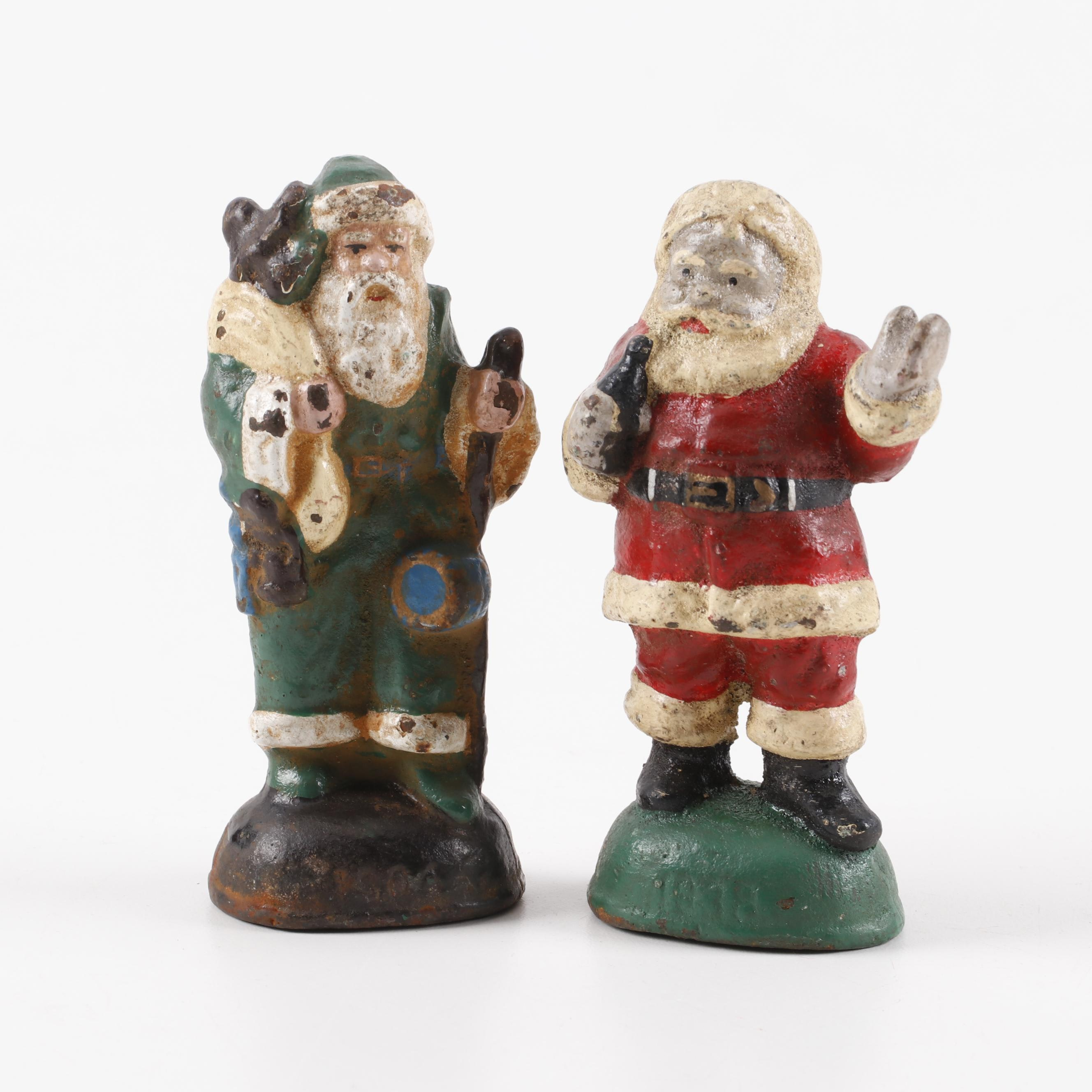 Hand-Painted Cast Iron Santa Claus and St. Nicholas Figurines, circa 1900