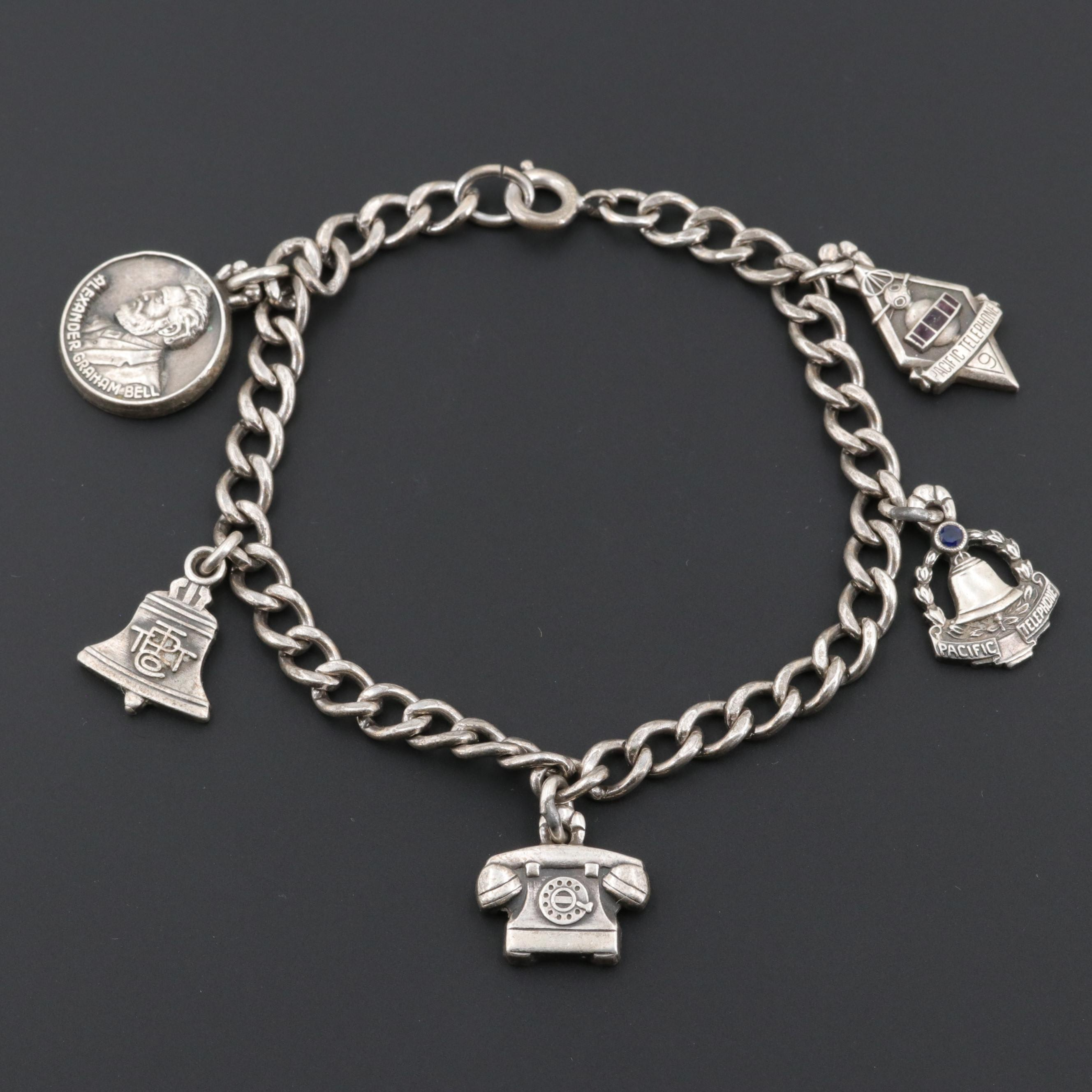 Sterling Silver Charm Bracelet Including Enamel and Synthetic Sapphire