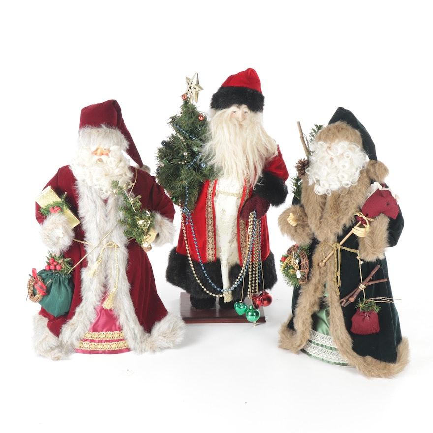 Trio of Decorative Santa Claus Figurines