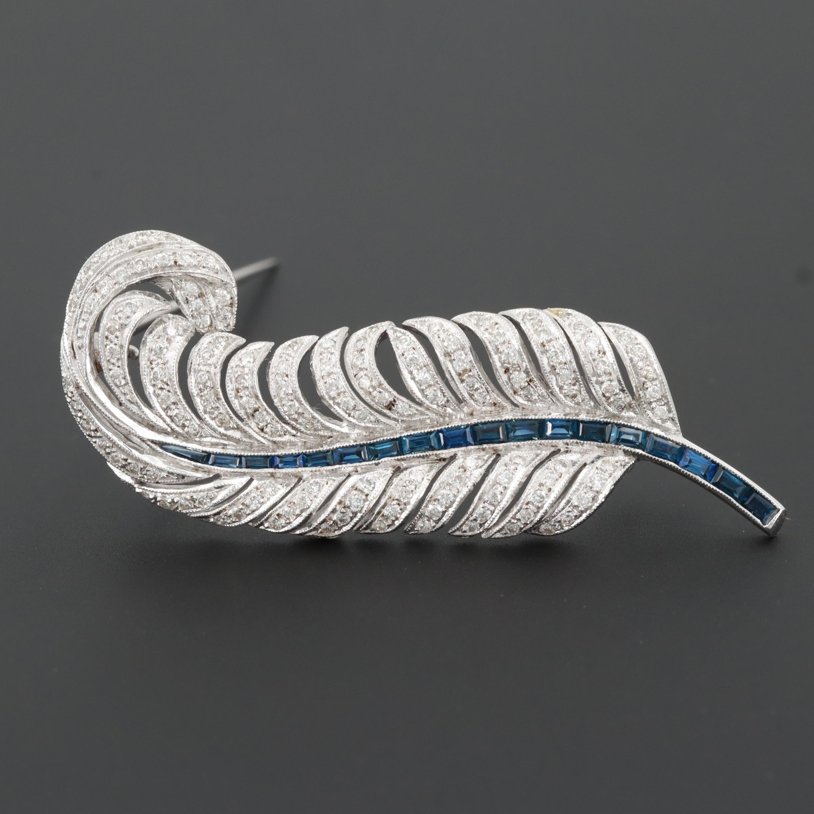 Circa 1940 18K White Gold Sapphire and Diamond Plume Feather Brooch