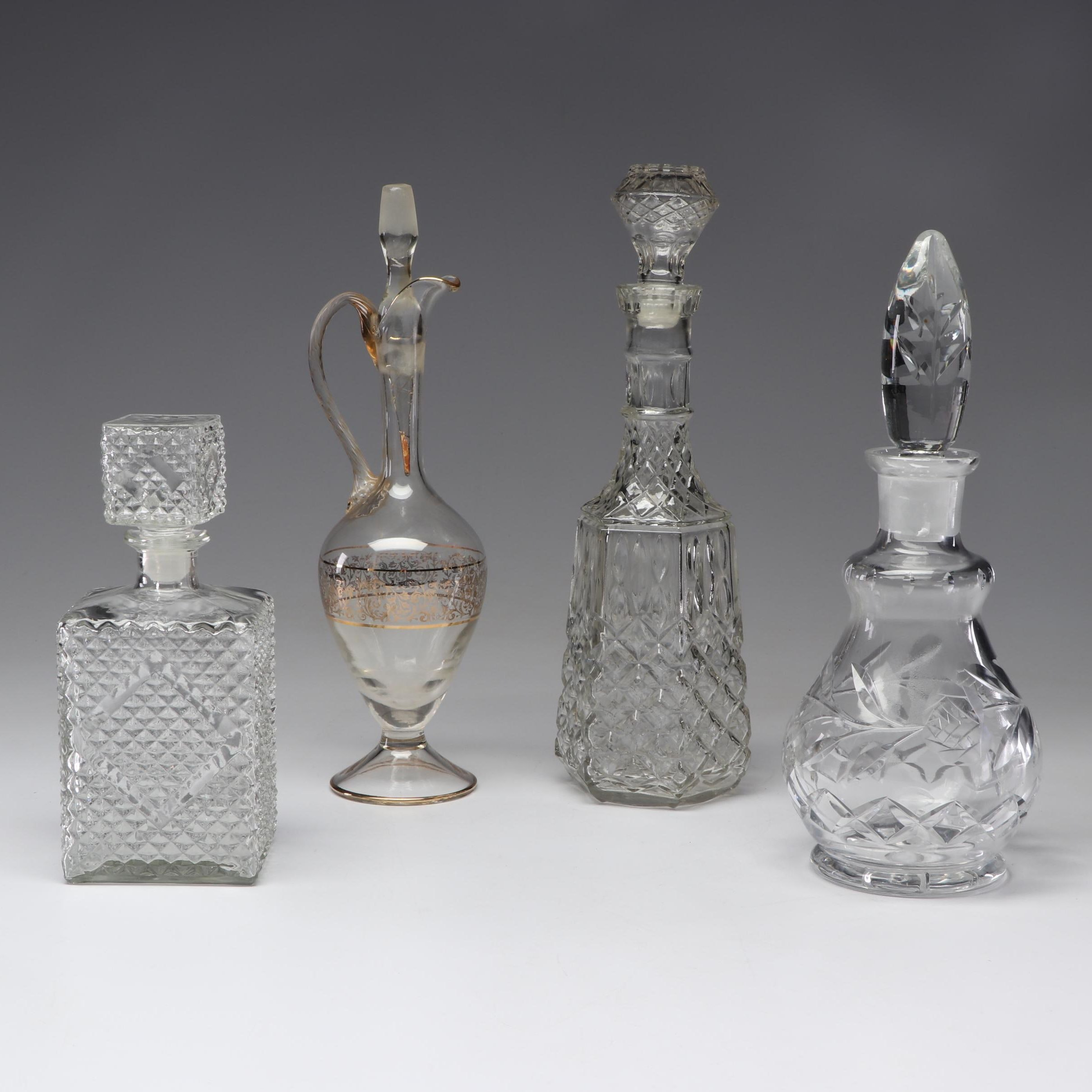 Collection of Cut and Pressed Glass Decanters