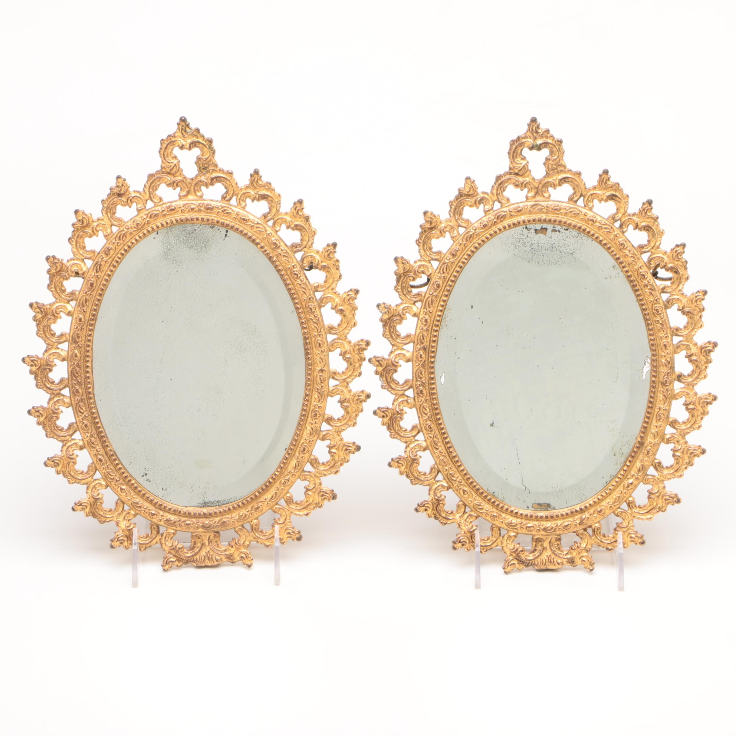 Pair of Baroque Revival Gilt Metal Oval Beveled Wall Mirrors, Late 19th Century