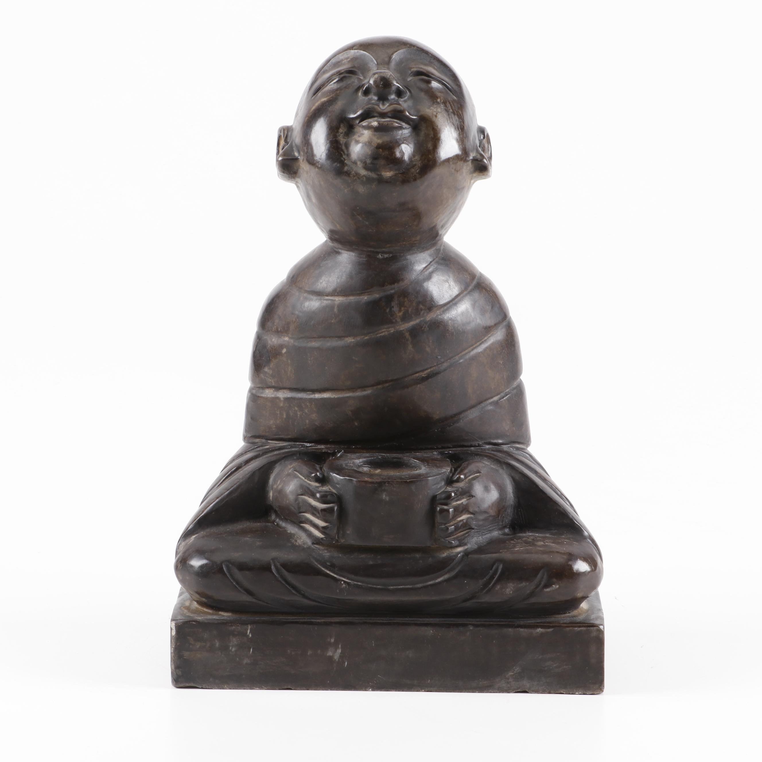 Stone Sculpture of a Monk