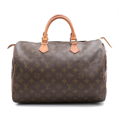58c6feb77ef8 Louis Vuitton Paris Monogram Coated Canvas Speedy 35 Handbag