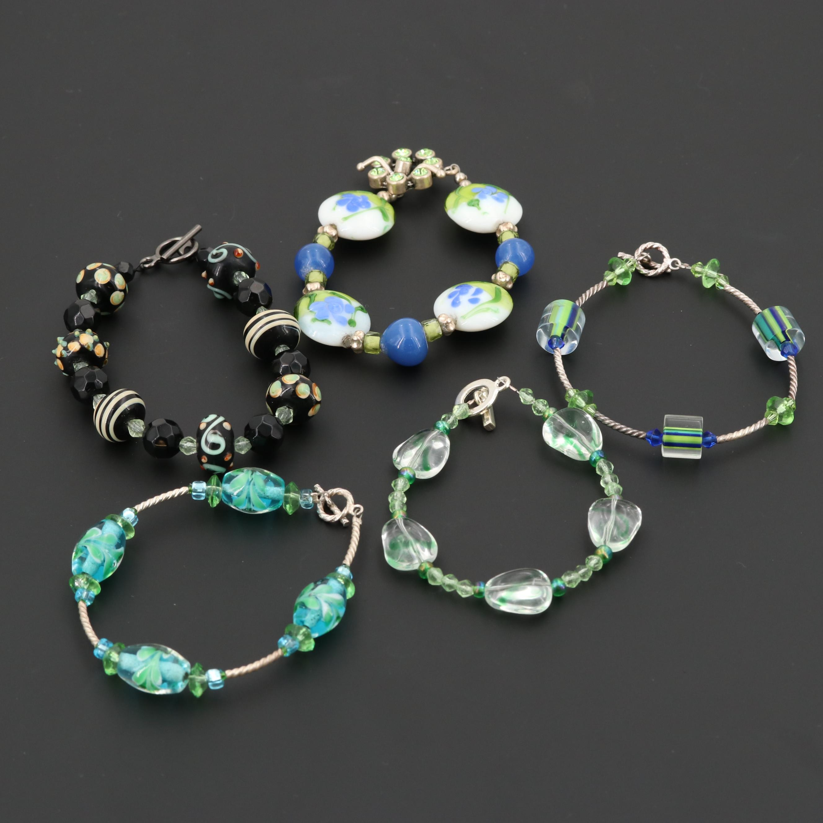 Collection of Sterling Silver and Silver Tone Multi Colored Glass Bead Bracelets