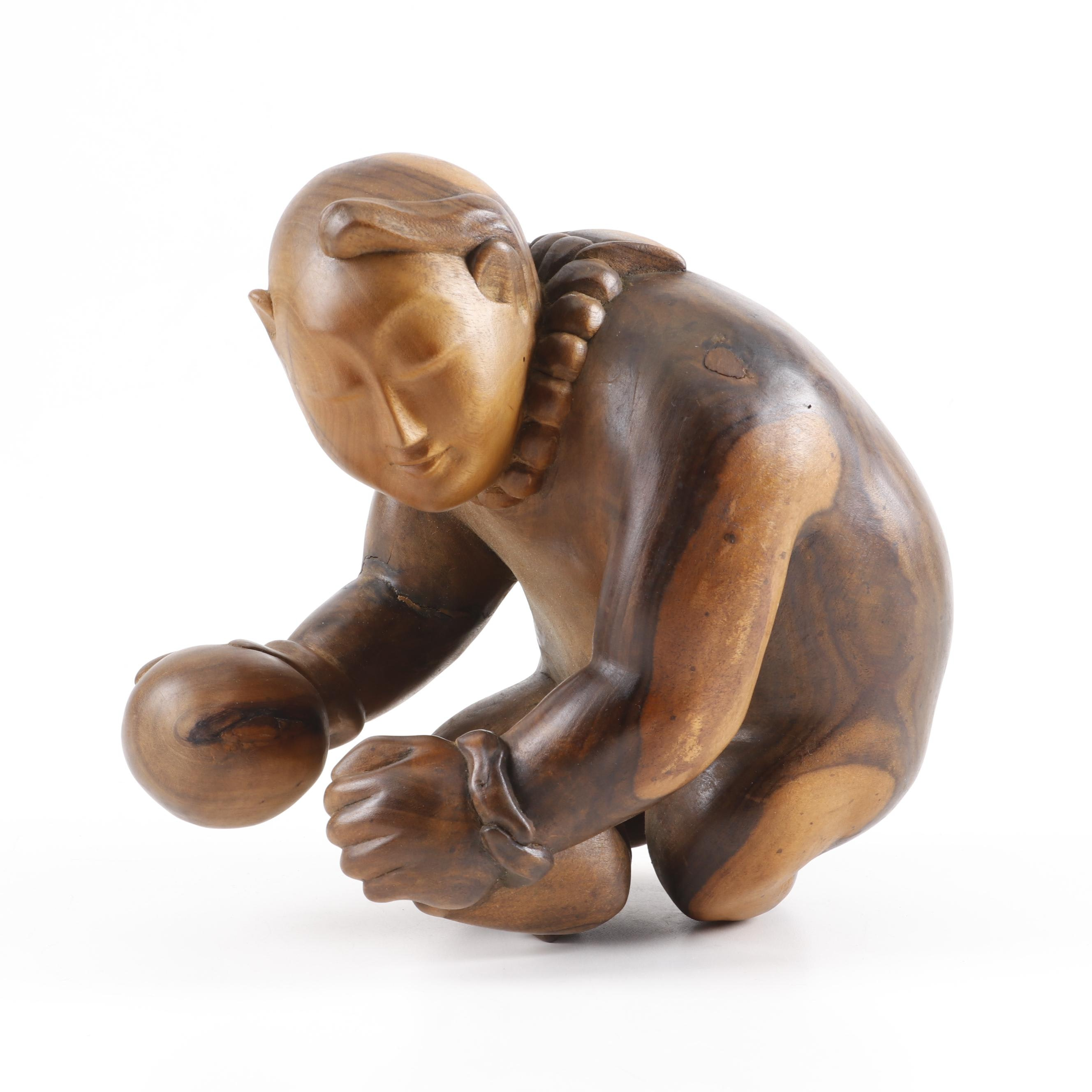 Carved Sheesham Wood Sculpture Depicting Buddha Holding Wealth Ball