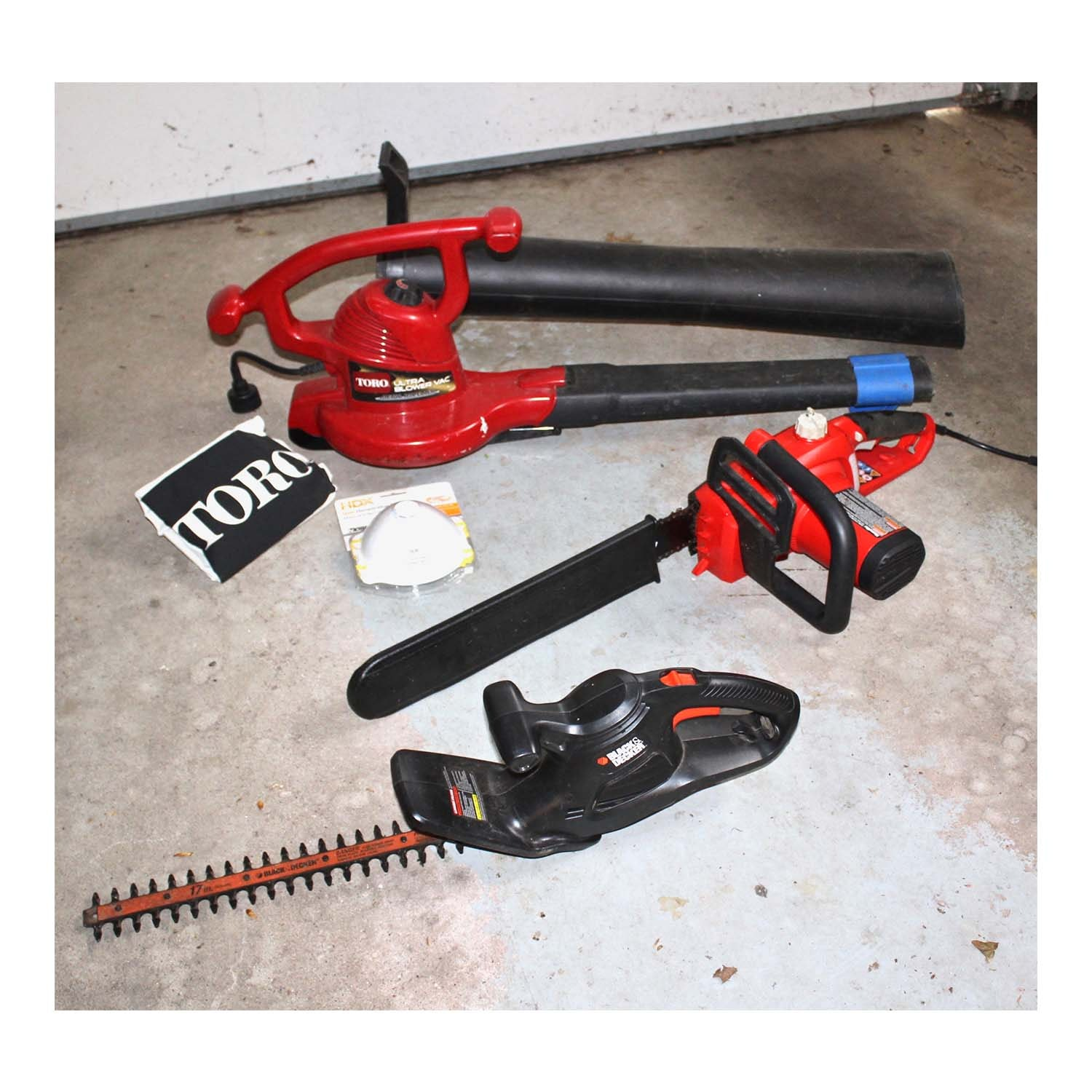 Blower, Hedge Trimmer, and Chainsaw Including Black and Decker