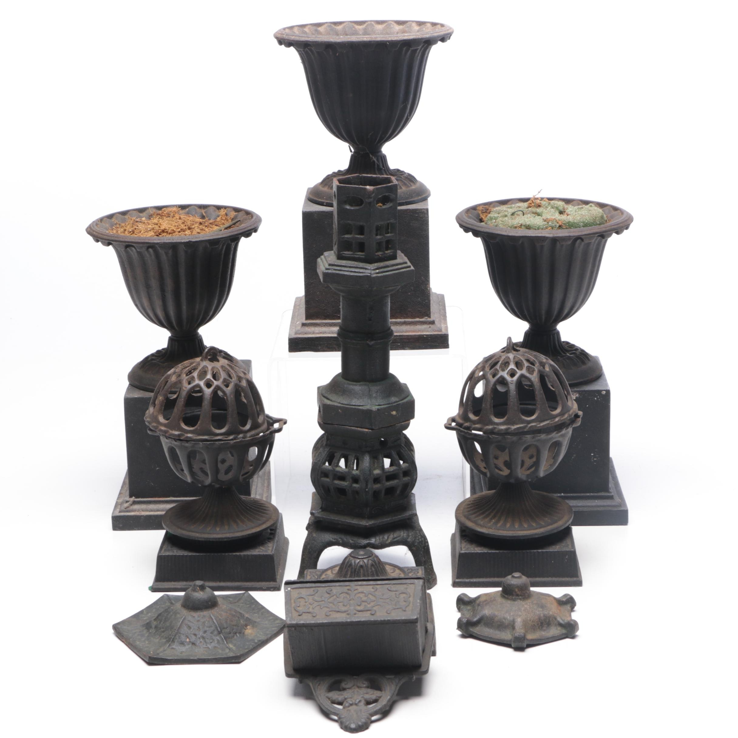 Group of Cast Iron Planters and decor