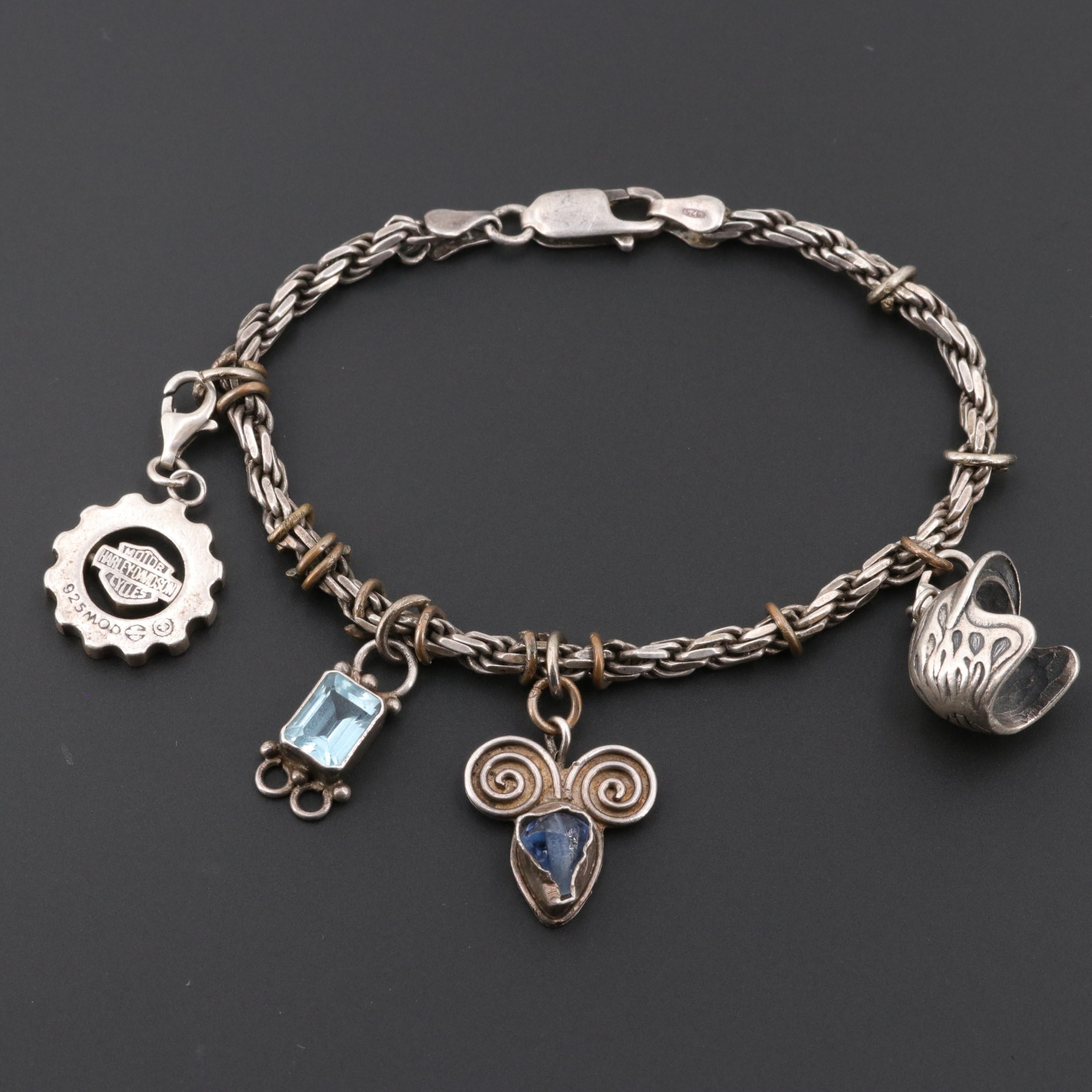 Sterling Silver Blue Topaz and Glass Charm Bracelet Including Harley Davidson