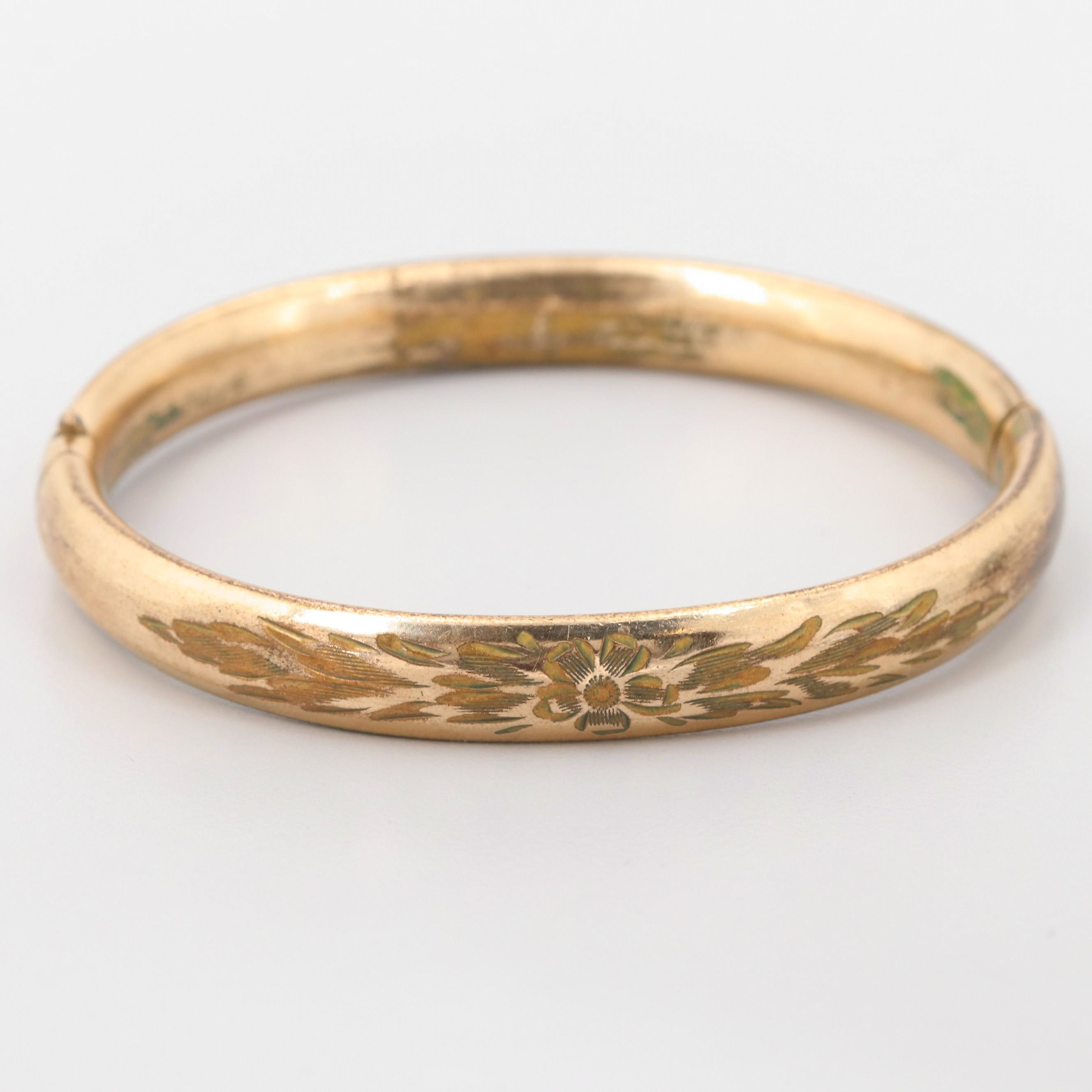 Gold Tone Bangle Bracelet with Floral Motif