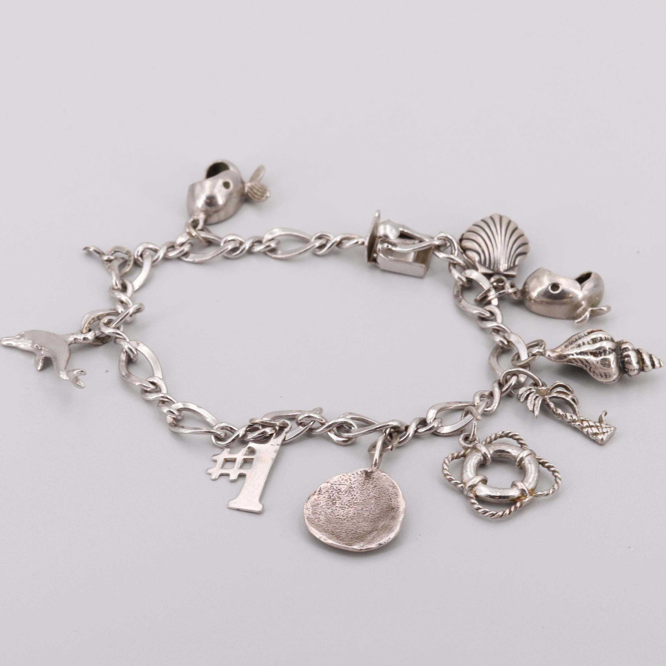 Sterling Silver Charm Bracelet Including Imitation Pearl Charm