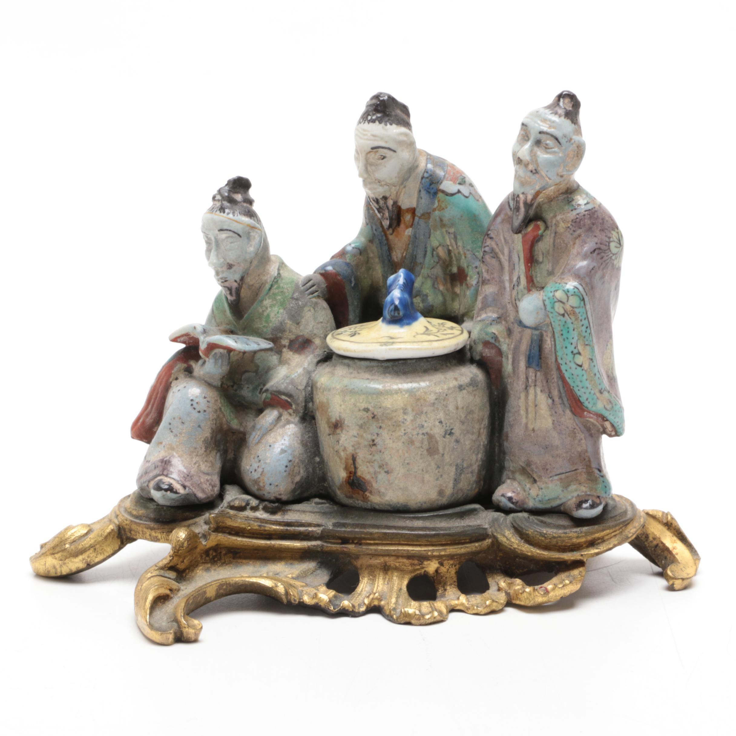 Chinese Ceramic Figurine with Brass Stand