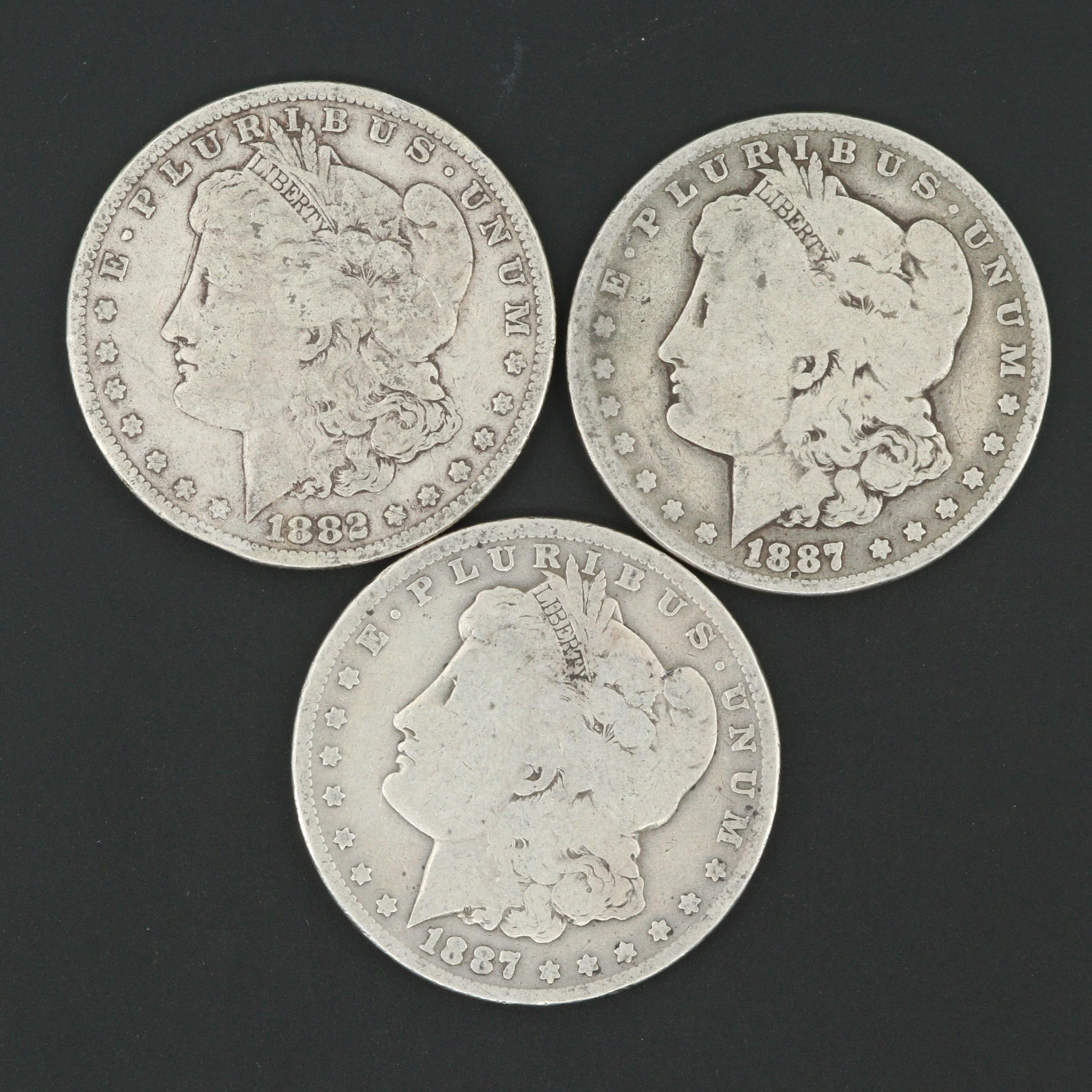 One 1882 and Two 1887-O Morgan Silver Dollars