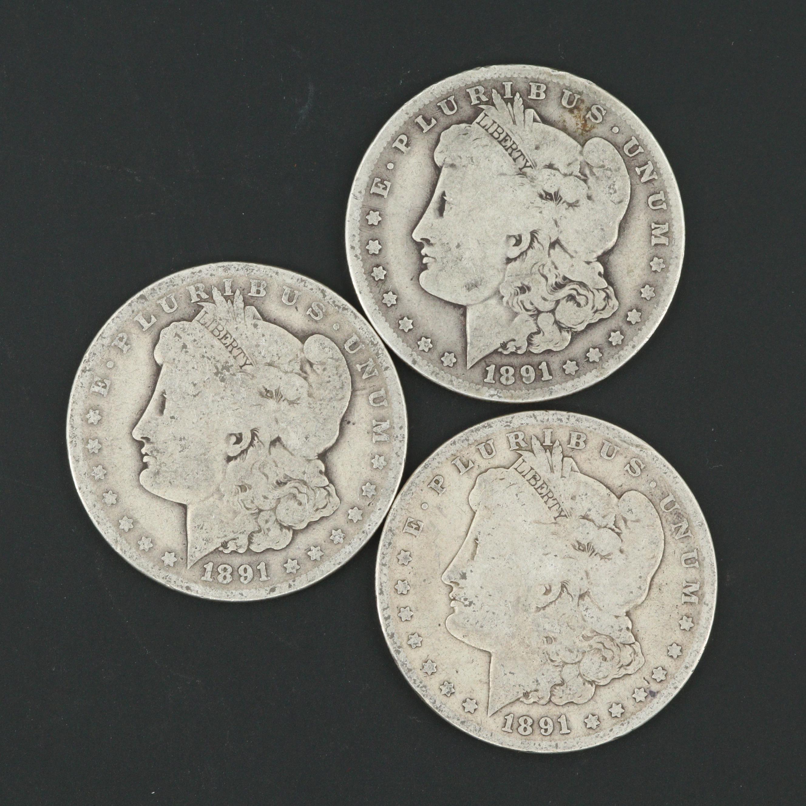 Three 1891-O Morgan Silver Dollars