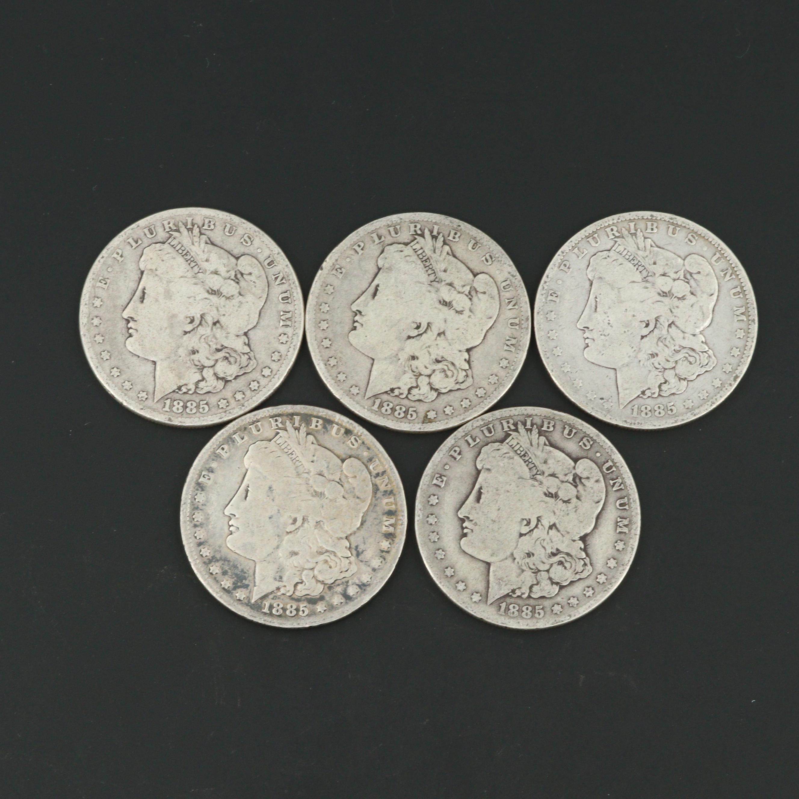 Three 1885 and Two 1885-O Morgan Silver Dollars