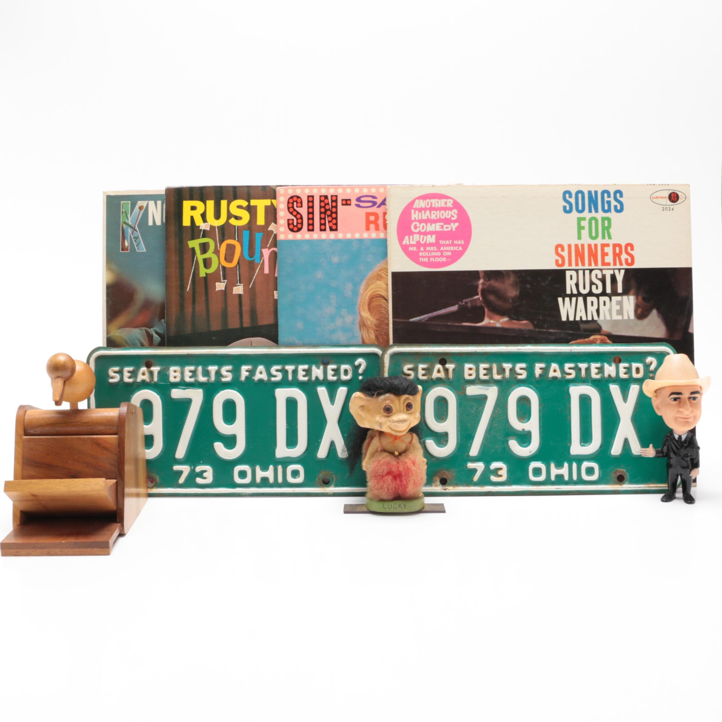 Cigarette Dispenser, Troll Nodder, LBJ Doll, License Plate and Vinyl Records