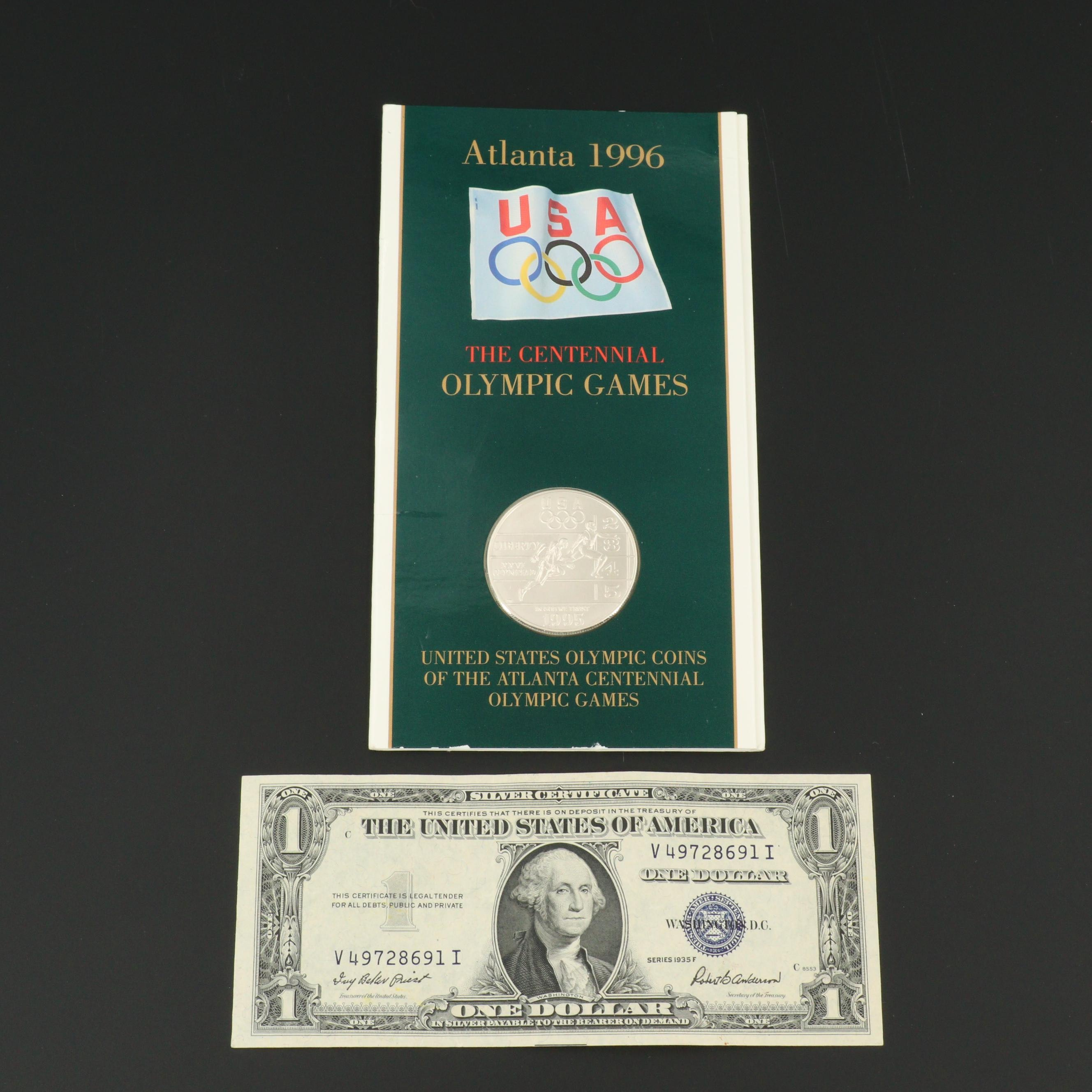 Series 1935-F $1 Silver Certificate and 1995 Olympic Commemorative Silver Dollar