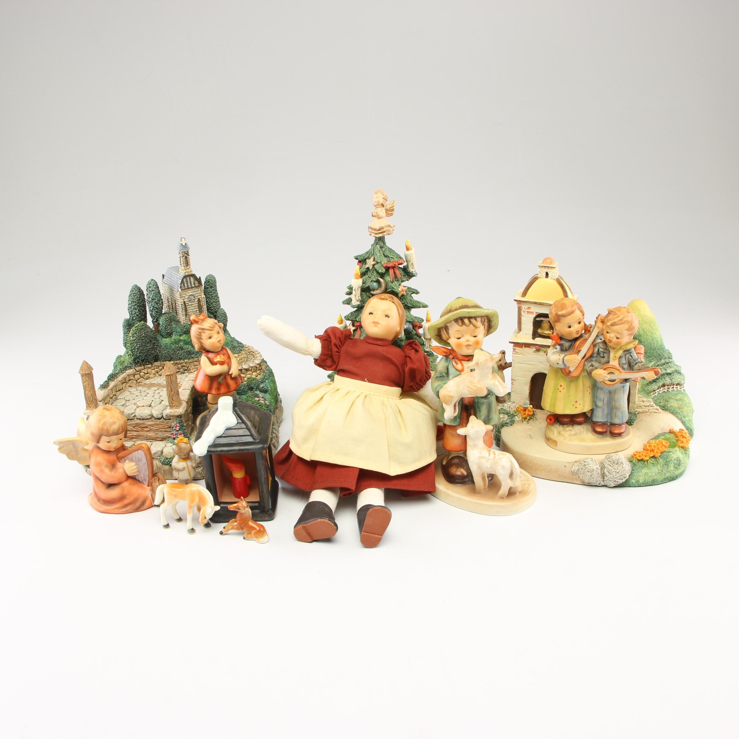 "Goebel Hummel Figurines and Doll Including ""Christmas Surprise"""