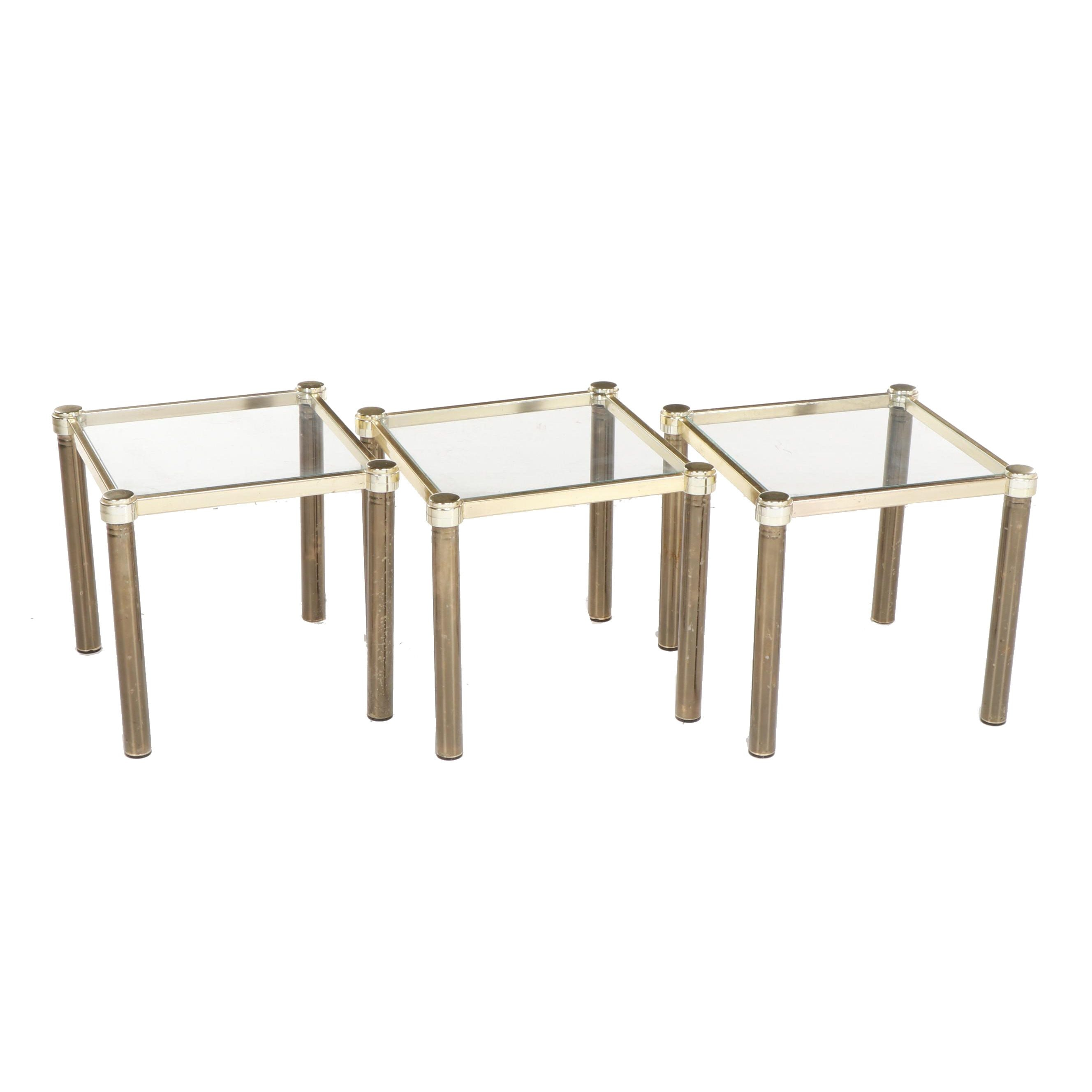 Three Contemporary Gold and Brass Tone Glass Top Side Tables
